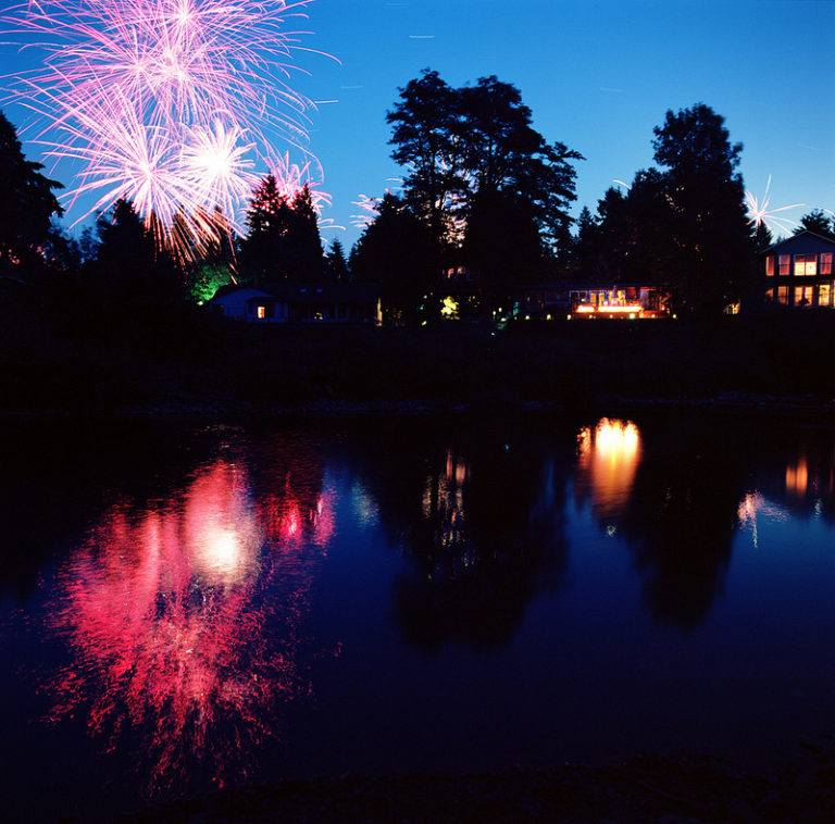 This glorious scene captures 12 whole minutes of freedom.   Fireworks in the River by Peter Carlson, a 12min exposure