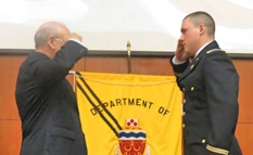 "Graduating Senior, Brian W. Giles '14, receiving his ""first salute"" from Brother Nicholas Scalera '63"
