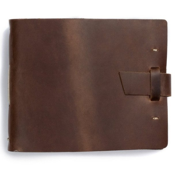 CUSTOM GUEST BOOK - $150-$200Handmade leather registry book with two lines of personalized text stamped on the cover. Measures 8