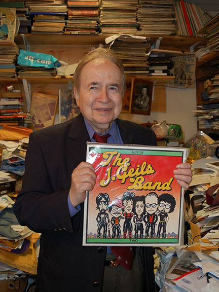 Joe Franklin (1926-2015) was a late-night TV talk show host, and his on-air presence was welcome companionship to NY illustrators on lonely all-night deadlines. He devoted an entire show to having The J. Geils Band on as his sole guests. And looky looky what he's displaying in his famously cluttered office! Thanks to Drew Friedman for sending me the photo.