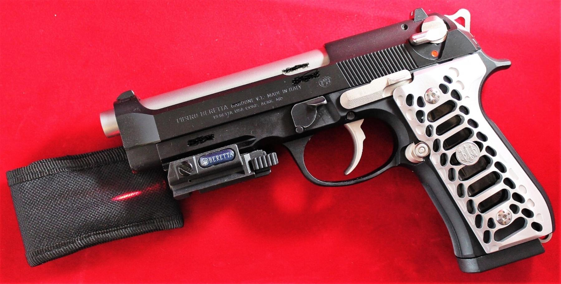 Beretta 92A1 9mm - Stainless performance parts, skeletonized hammer, Valkyrie Cobra grips, Beretta laser and logo medallion back on.
