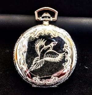 Great grandson wanted to preserve the story of the pocket-watch. Lightly engraved a pheasant and Art-Deco scrolls to keep the watch close to the same era and preserve the 'antique' look.