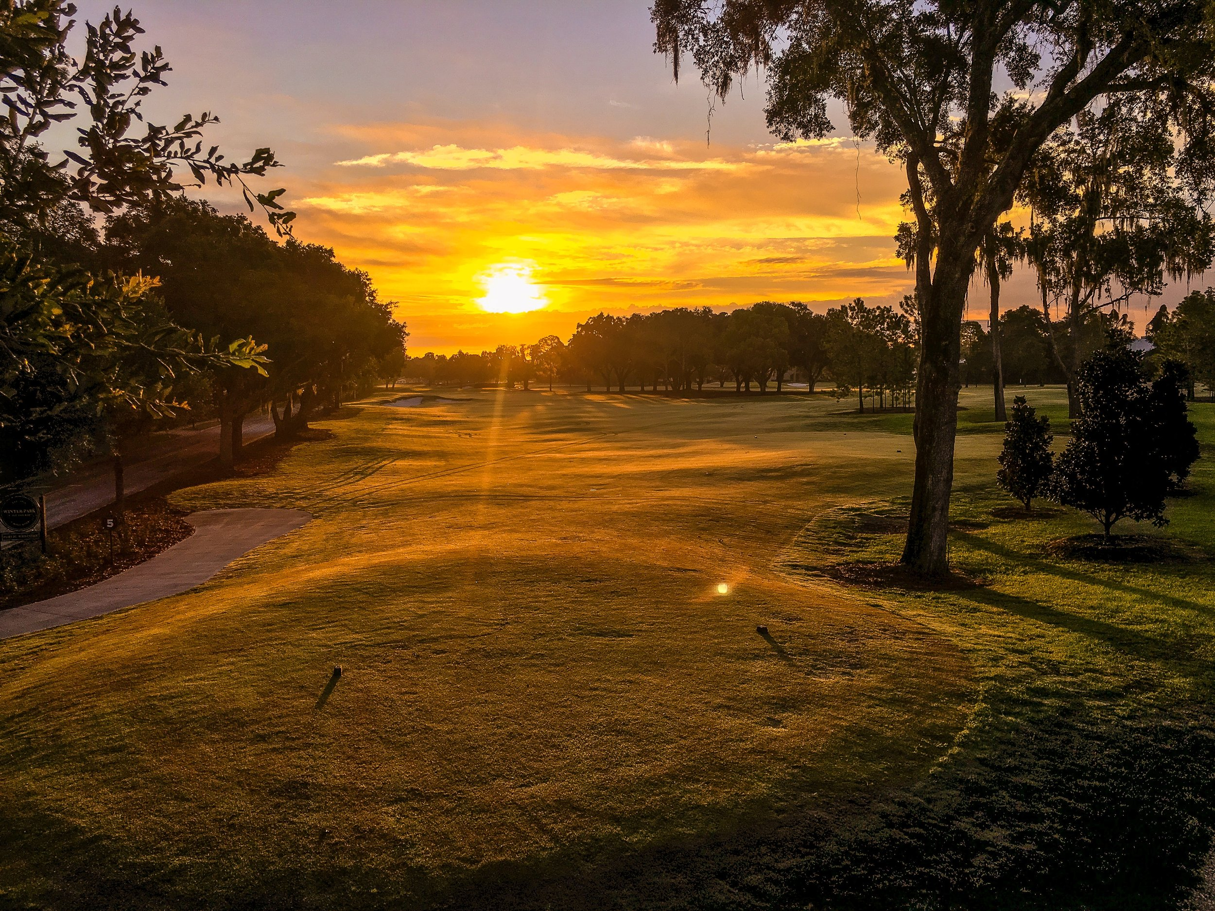 The sun rises on the 5th hole on opening day.