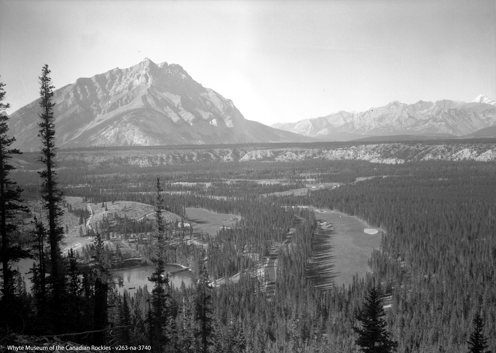 The 'Cauldron lands' as seen from Mount Rundle includes current holes 3, 4, and 5. Look closely and you can see a canoe floating in the Devil's Cauldron (bottom left).