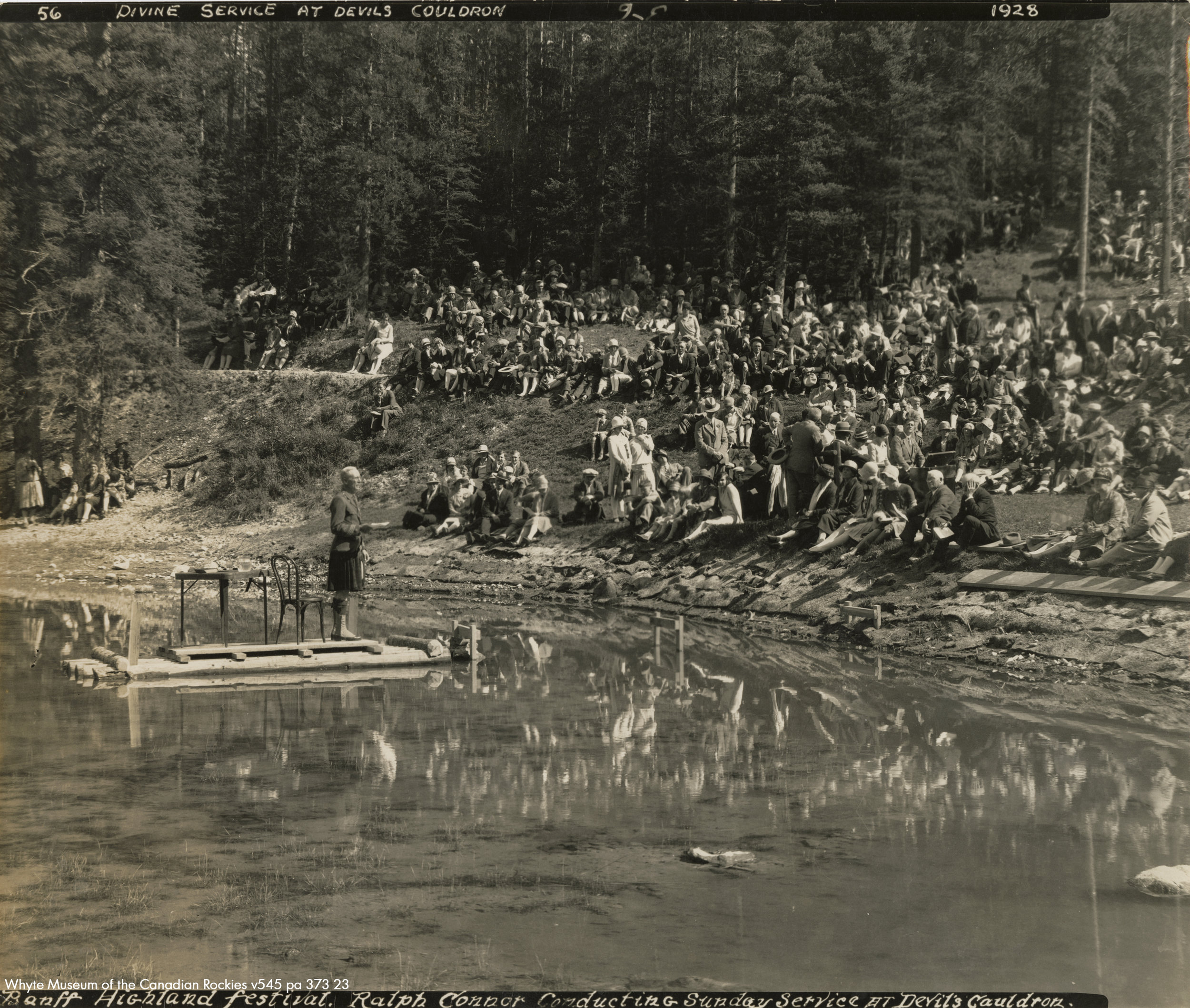 Reverend Ralph Connor giving his sermon September of 1928 from a floating raft in the Devil's Cauldron. No bunkers present.
