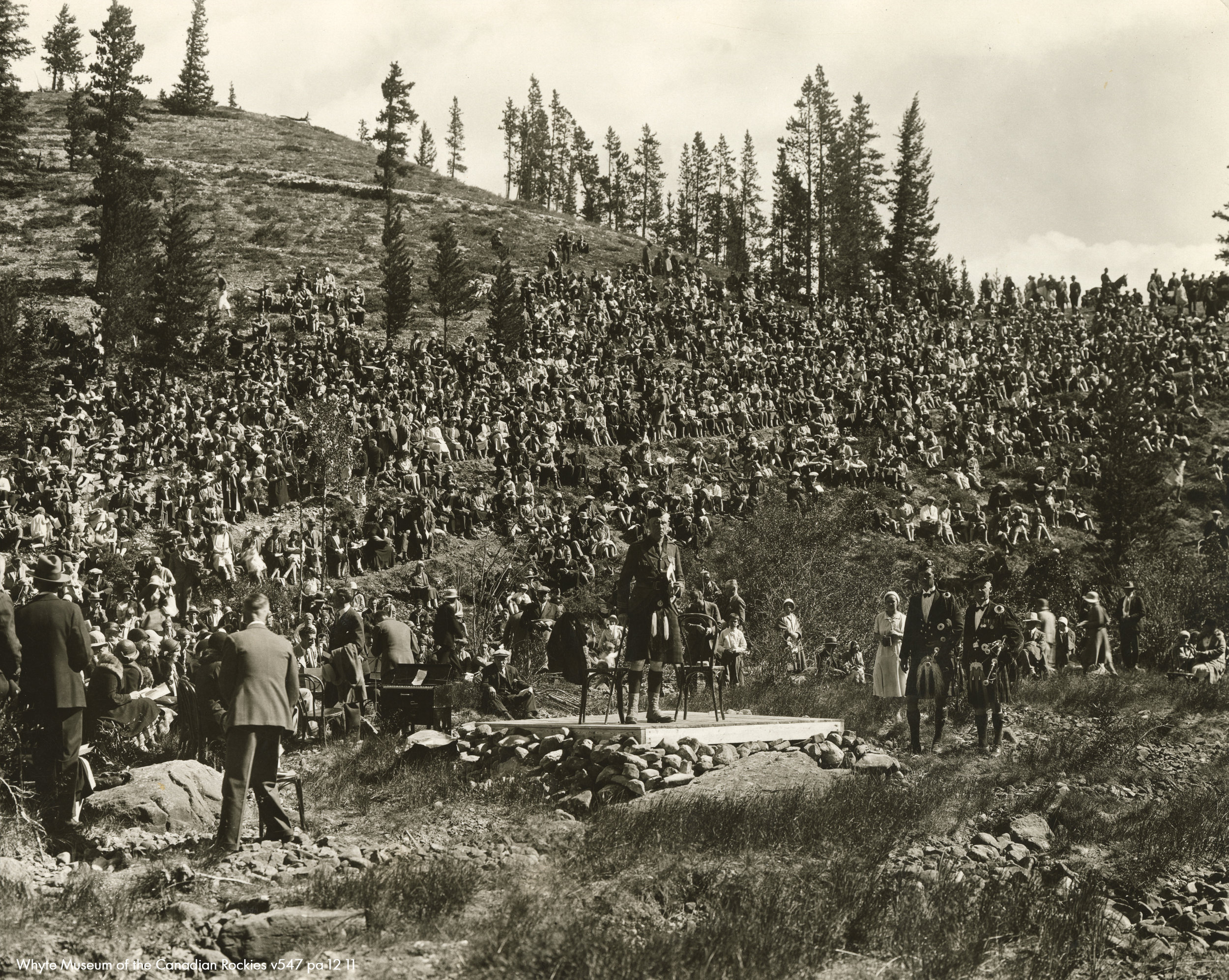 In front of thousands of attendees, dancers and musicians perform at the Banff Highland Gathering & Scottish Music Festival in the Devil's Cauldron. This photo is from the 1930 gathering and shows the view looking up towards the tees.