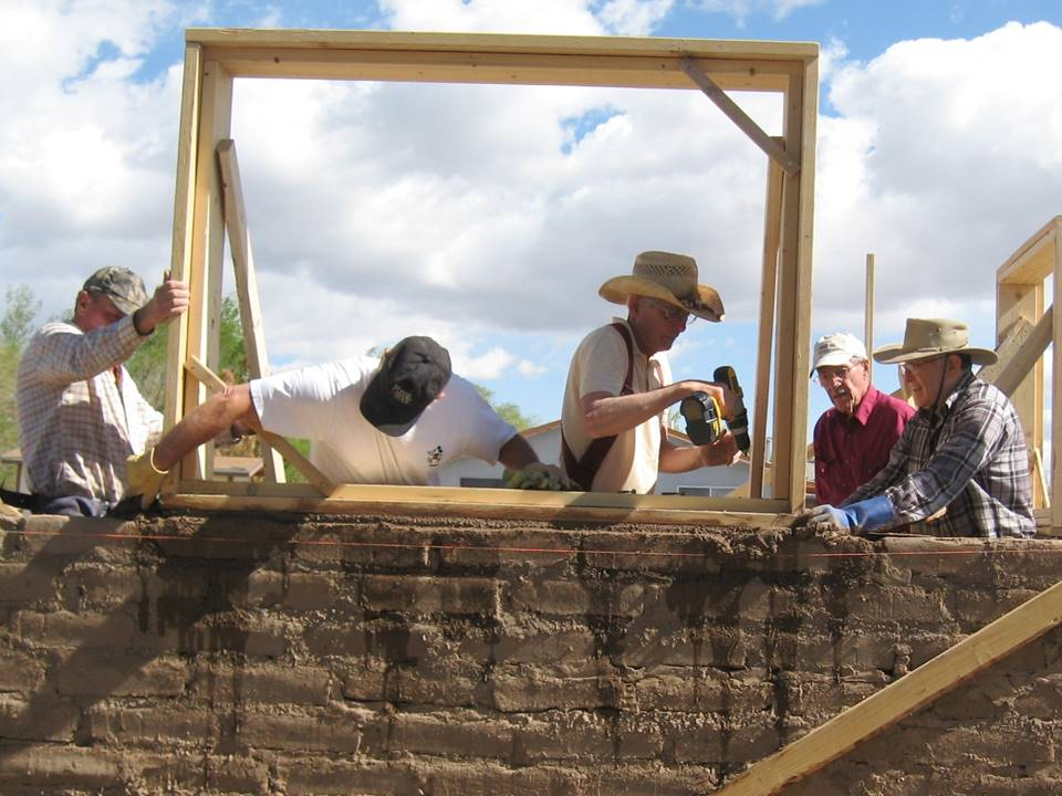 Building Houses, Building Hope: Volunteers working hard on an adobe house constructed under the auspices of the San Luis Valley Habitat for Humanity.