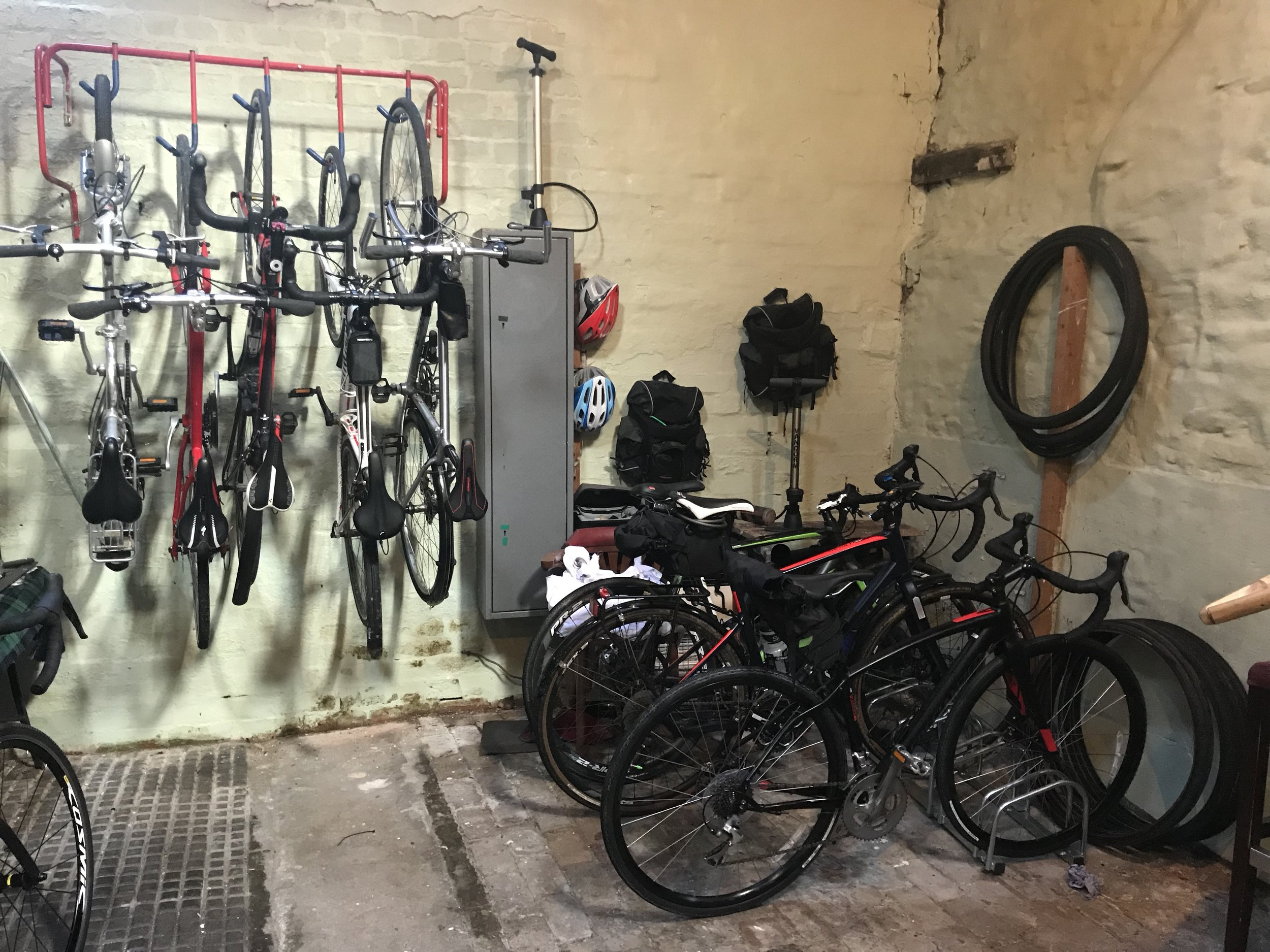 Our safe lockable bike store - bring your own or hire gravel bikes, e bikes or top end road bikes from £30 a day - we're a bit bike bonkers !!