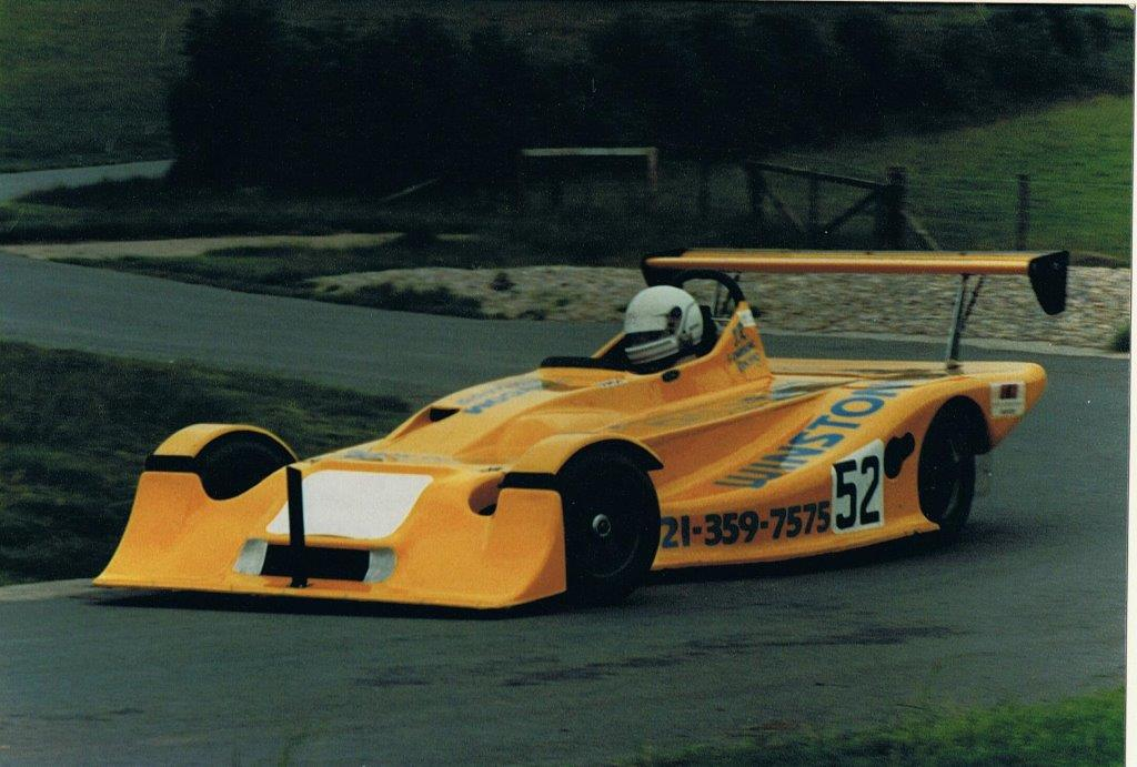 1985 MK27 - Clubmans Formula car with a similar chassis to the MK26: front radiators, an even longer wheelbase and conventional bodywork. The most important and innovative change was the introduction of the Mumford rear suspension lateral location system, Arthur developed this in conjunction with Michael Mumford. The system had the following features: nil spurious vertical loads, excellent roll centre control, very low RCs achievable, very low chassis mounting loads, all contained within the under tray, allowing optimisation of under aero. It remains the definitive live axle lateral location system.Successes included: 1986 - Tony Bridge, Slington & PHM Clubmans champion. 1986 - RIchard Gilmour (MK18.27) Formula 1300 champion. 1986 - David Grace (MK14/25 and MK27) Harewood Hill CLimb champion. 1988 - Richard Gilmour (MK18/27) Formula 1300 champion.