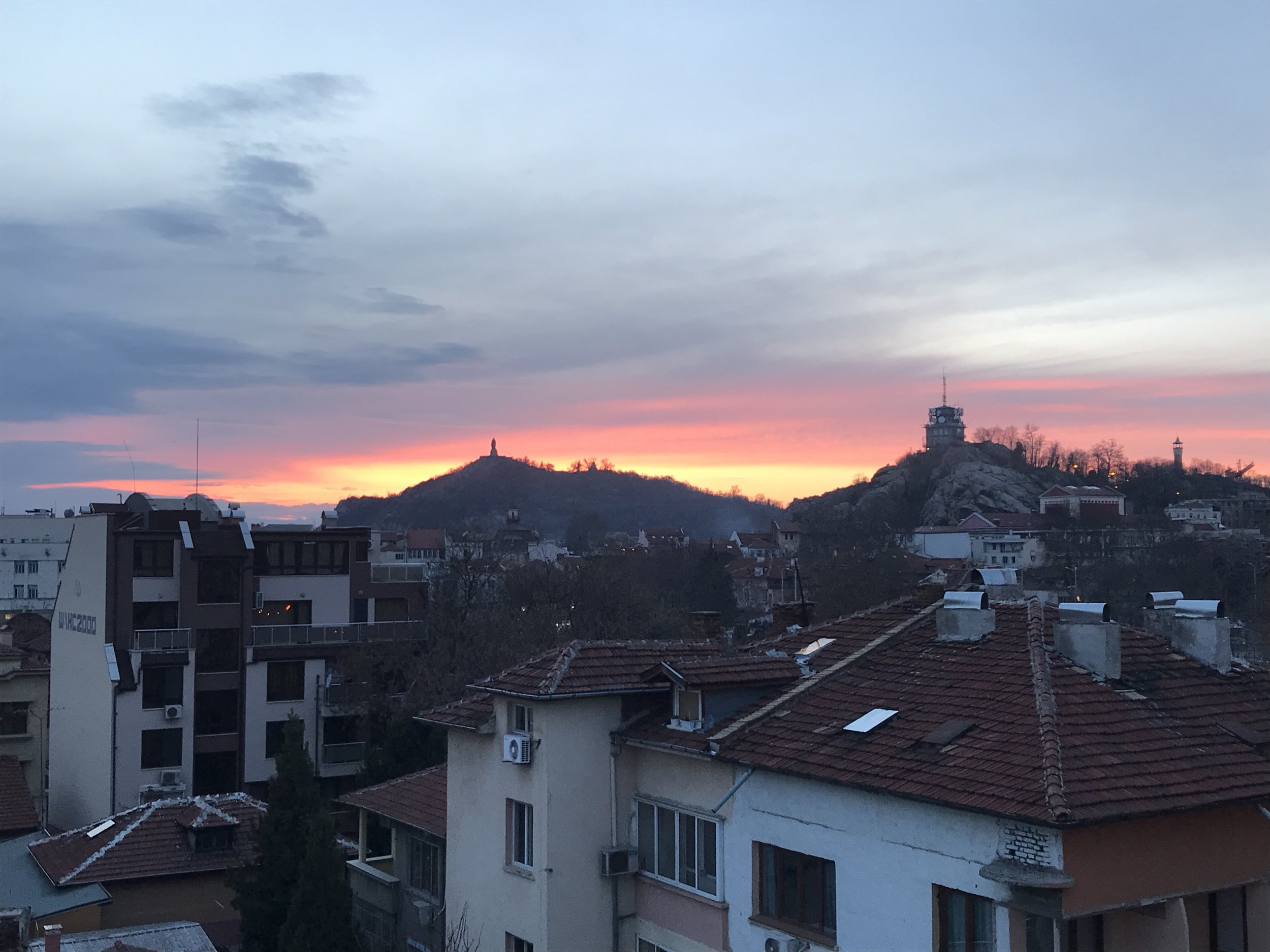 The sunsetting behind some of plovdiv's hills