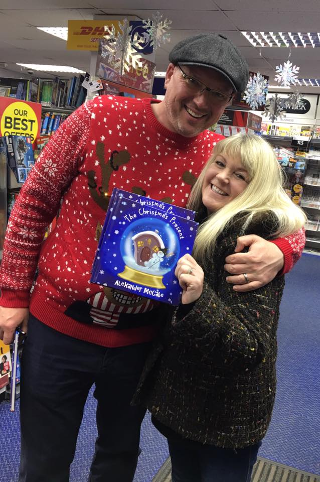 Alexander McCabe with Patricia Pryde at    WHSmith in Cupar   , November 27, 2018   Photo credit: Patricia Pryde