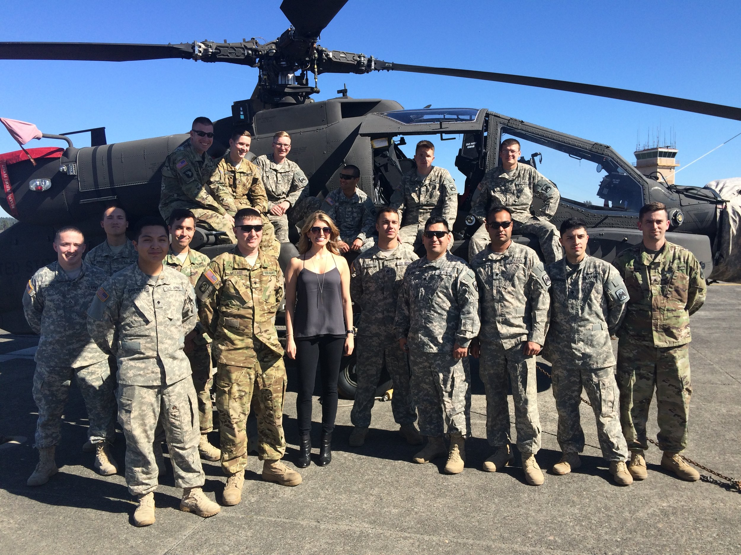 Janine with military members at Joint Base Lewis McChord in Tacoma, Washington