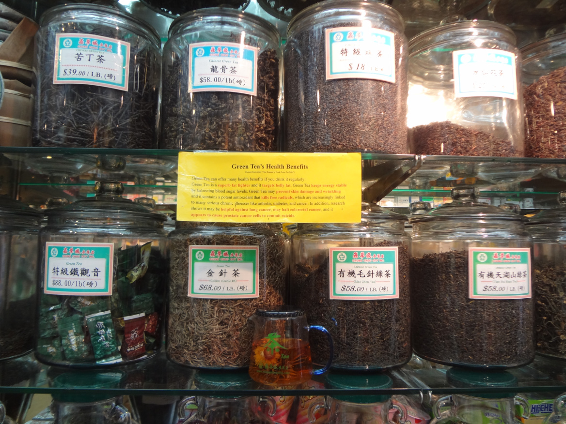 """One store sold only dried or """"preserved"""" foods. The main options seemed to consist of dried mushrooms, preserved ginger, or preserved fish. Next, I came across a candy store that sold all sorts of candied, dried or preserved goodies. They encouraged sampling as much as I wanted so I really took advantage of it. Next to each tin would be a plate filled with samples and then standing all over the store were employees with bags who would fill your order. I tried everything from meat jerky to candied kiwis to spicy candied ginger. I left with some candied plums as well as sweet preserved rose petals."""