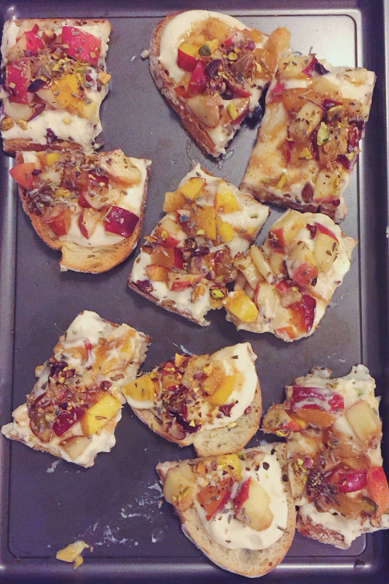 I think that bruschettas and crostinis are some of the simplest crowd pleasers to prepare when you are entertaining a large gathering of people. They are extremely simple to make and are so versatile that the options are endless! Sometimes I choose combinations myself and prepare the meal before laying it out on platters as guests arrive. This is nice because it creates a beautiful presentation. Conversely, it's a lot of fun and even less work to arrange the individual components of the dish and allow friends to compose their own crostini creations.  I really love having friends over and testing my experimentations on them! Occasionally I will have an impromptu dinner where I prepare the food and friends bring what they can to contribute. It's always a lot of fun and these gatherings have been so successful that we have started to migrate from apartment to apartment! One night of late, we moved the party over to Brooklyn for an evening of food and drinks along with an assortment of strangers and friends all thrown together. I decided to go with the flow and plan my menu for the night based solely on whatever looked good that morning at the Union Square Greenmarket. Thus, the crostini extravaganza was born.  Harvest season is in full swing so I was overwhelmed with options. Gorgeous greens, brightly colored peppers, sweet corn by the barrel, tubs of tree fruits, heirloom tomatoes- everything was beautiful and fresh. I really like to cook by color so I picked up anything and everything that looked unusual. By the end of my shopping spree I realized I may have overdone it a little bit but was lucky enough to find out that some friends were in the area. I met up for a quick exchange of goods so that I didn't need to trek all the way to Brooklyn with my groceries.  The final menu took shape on the spot and the combinations were as follows:  -Spicy tomato sauce, sweet corn, dollops of ricotta, and assorted sliced peppers  -Mozzarella, hazelnut basil pesto, and heirloom to