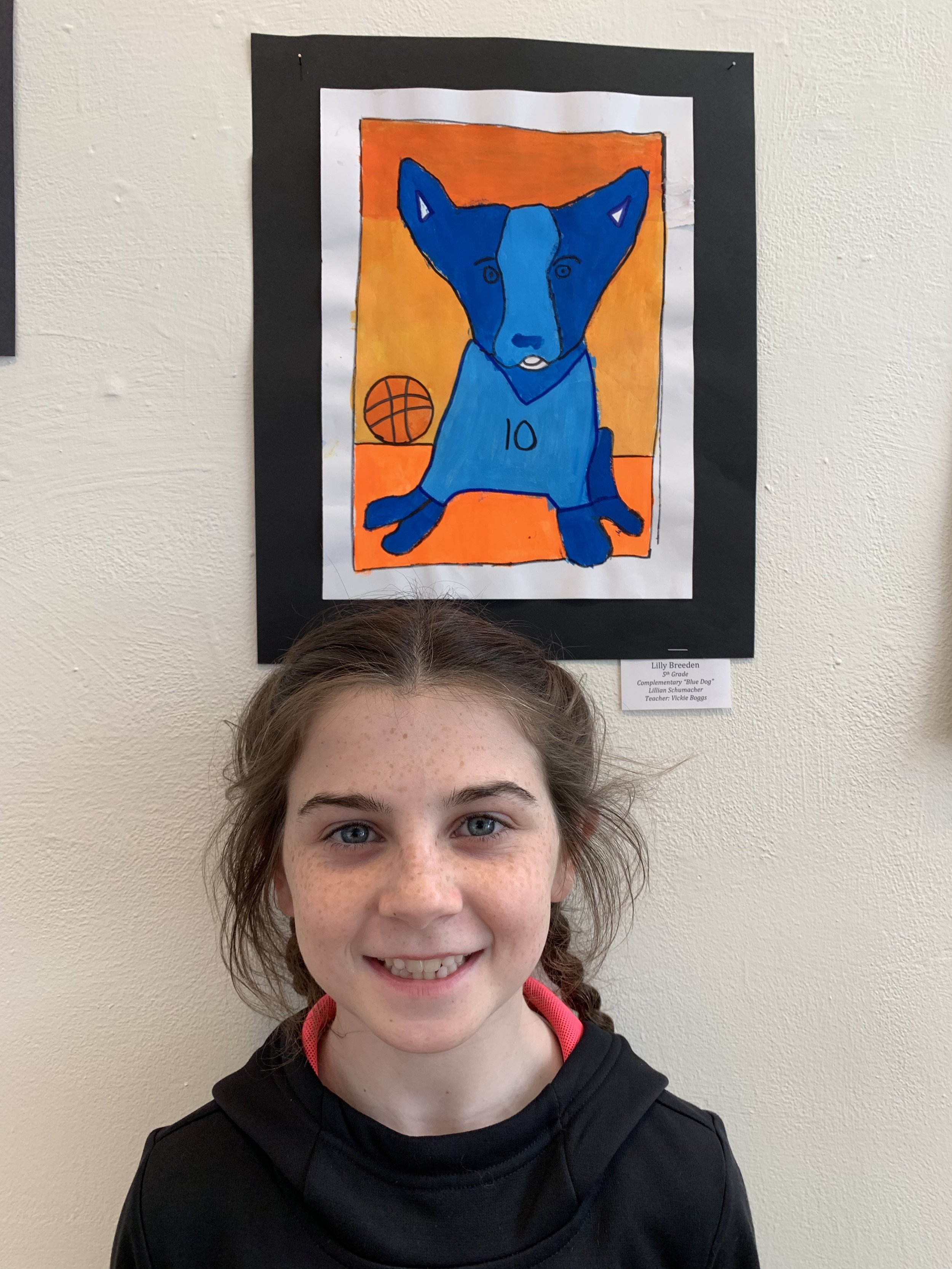 "Congratulations   to Lilly whose ""Blue Dog"" was chosen for exhibition at the Stocksdale Art Gallery at William Jewell College. Lilly, is that Rosco? Blue and orange are GREAT complimentary colors. And I love the bit of white in his ears and mouth too. Is #10 your number? (My daughter's number was #10 too - in volleyball.)"