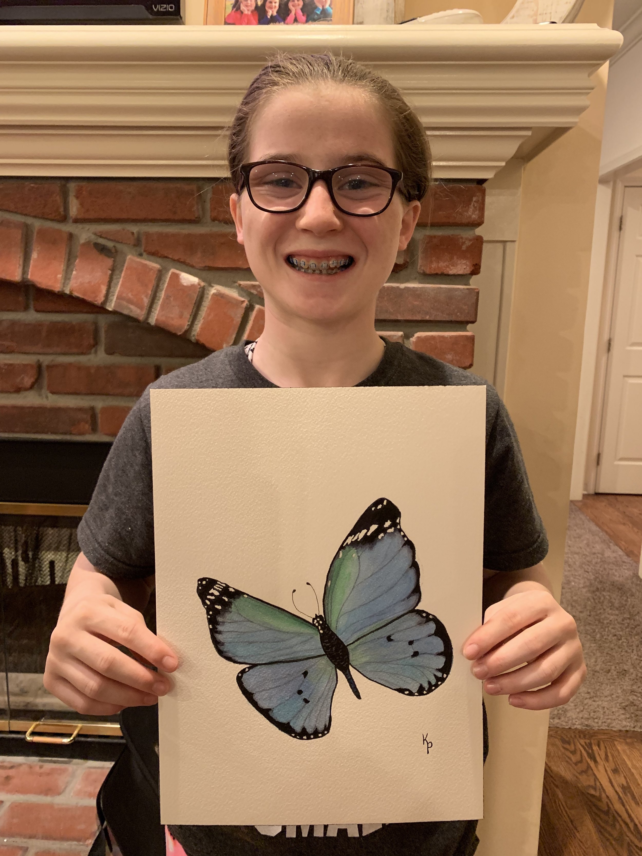 March winner,  Jaden, loves the butterfly I painted. Zoom in and you'll see the sparkles added to the wings with a watery layer of silver.   April winner:  Edith won her choice of a hardback copy of Rascal's Trip for her daughter Sabrina. Next month, she will share a photo with us.   May winner:  Another original watercolor will be the May giveaway - to be announced June 1st.