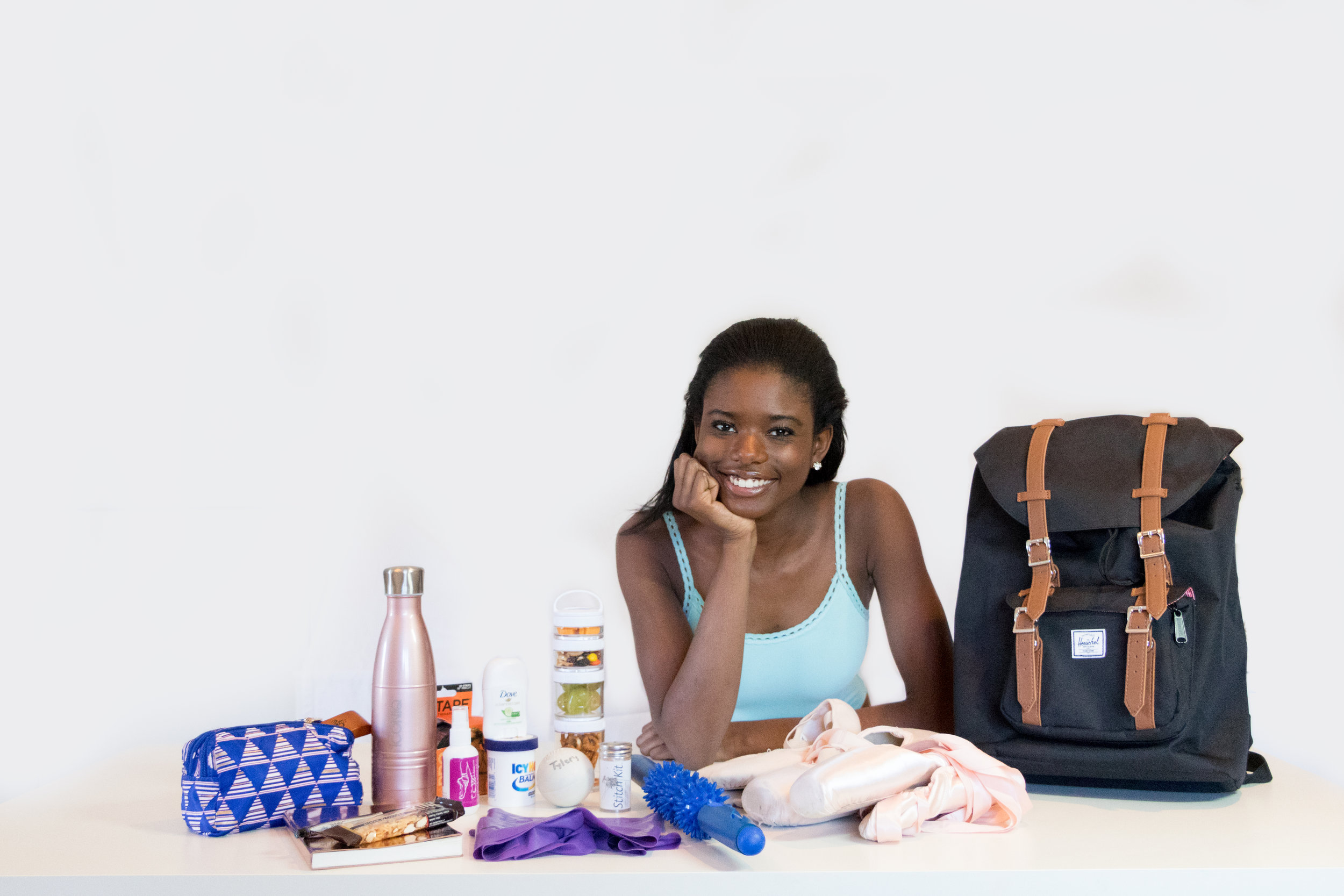 Inside Her Bag... - Tyler is a Professional Division dancer at Alvin Ailey in New York City. Tyler's days are varied and may include pointe class, Graham Technique, yoga class, costume fittings, master classes and performances. Here's a look at the everyday essentials that keep Tyler organized.
