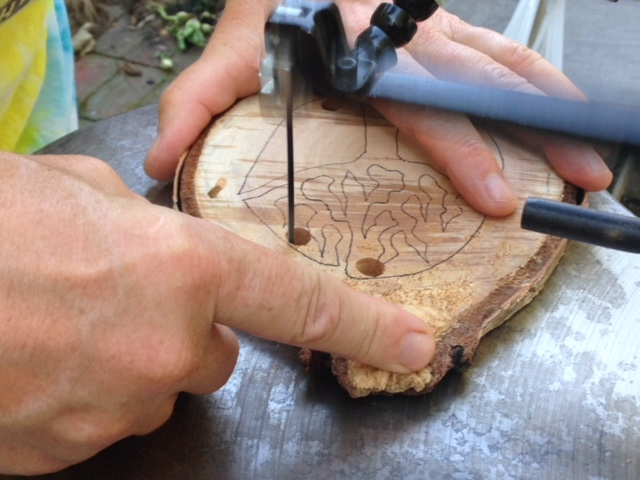 Once the tree rings have thoroughly dried, Deb uses a scroll saw to cut out the silhouette of a tree.