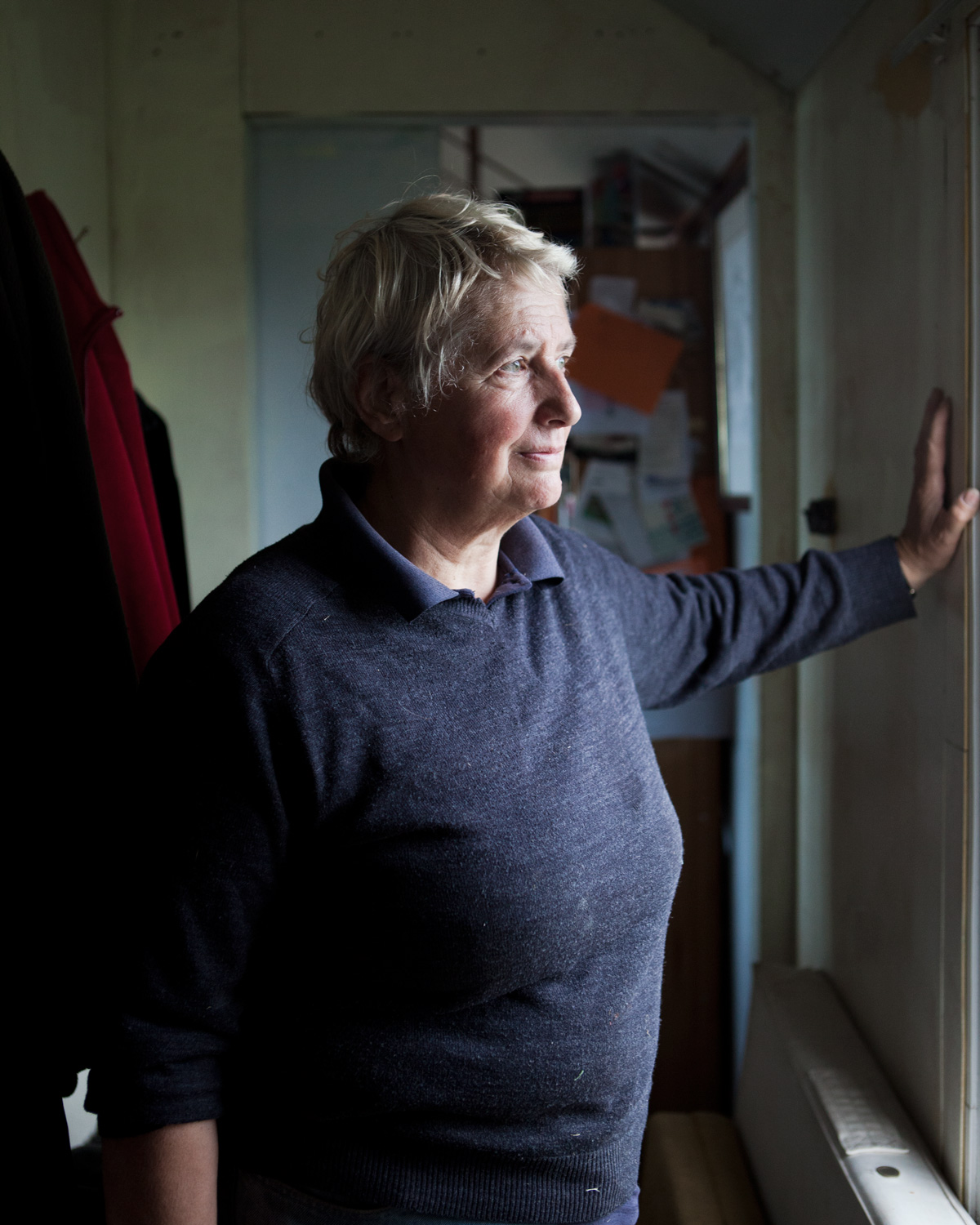 Bryony in her home that she bought in 2008; believing at the time  that sea defences would be kept up and her house would be safe for a number of years.