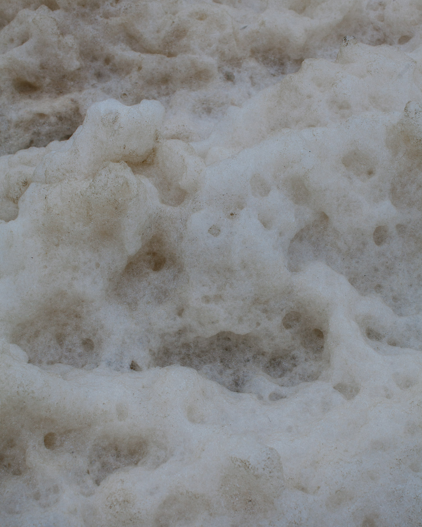 Sea foam residue left by the waves.