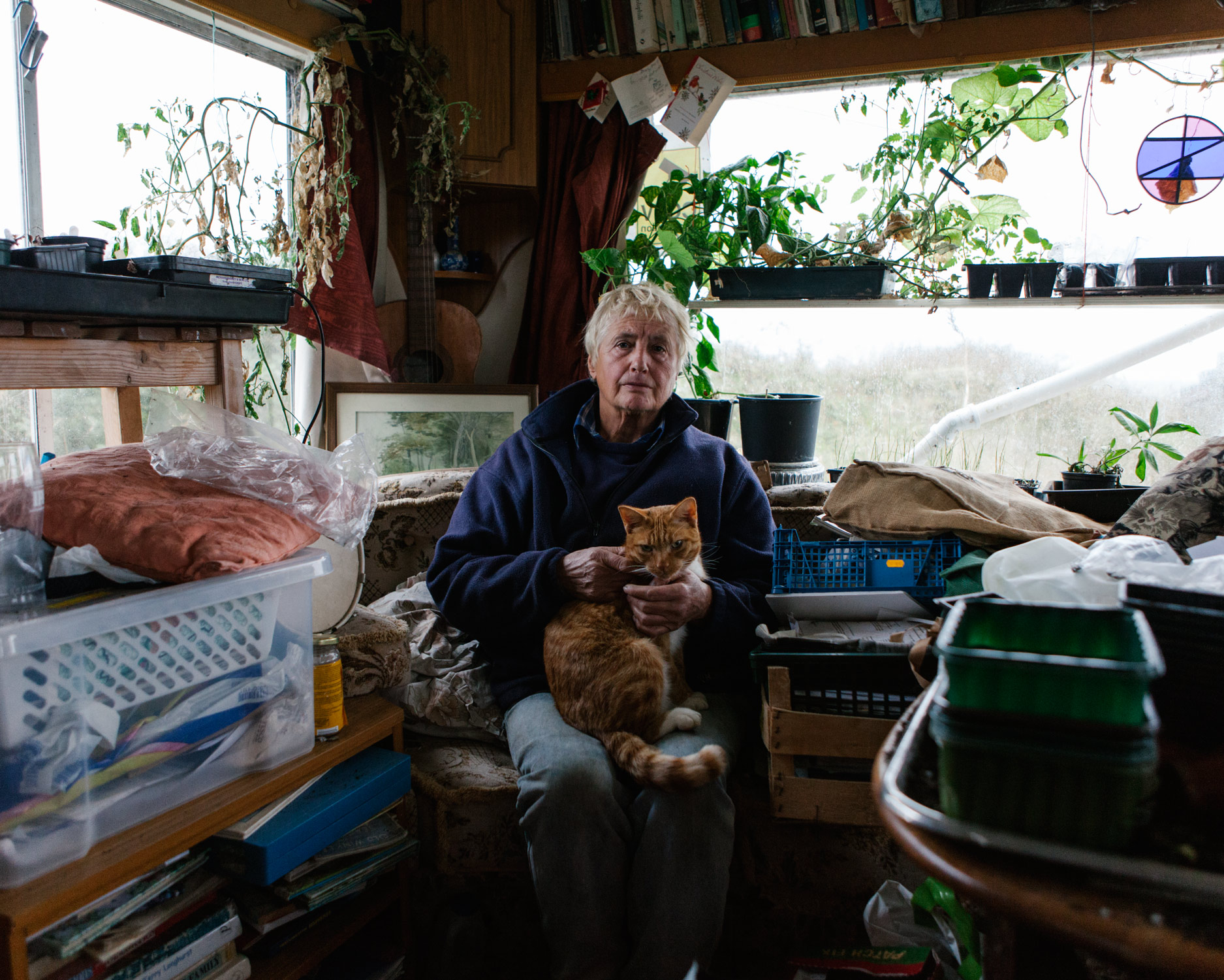 """A big tidal surge in 2013 finally undermined Bryony's bungalow. She was forced to move across the street and into a caravan with all her possessions.""""At the age of 70 I've lost my house and now I'm on the verge of losing everything. I'm fighting to keep my life together."""" - Photograph taken in 2017."""