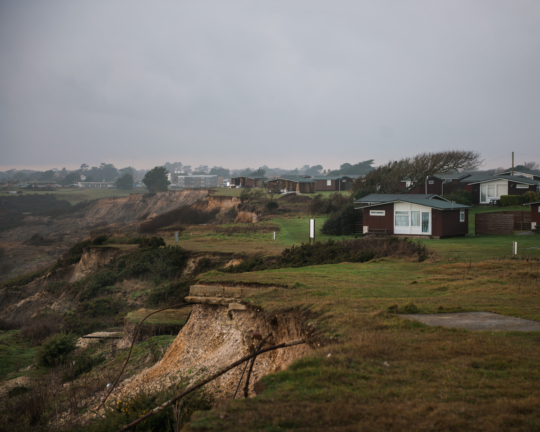 A holiday home park is battered by the prevailing easterly wind in West Sussex. The park has already had to move a significant amount of the homes back from the edge of the cliff.
