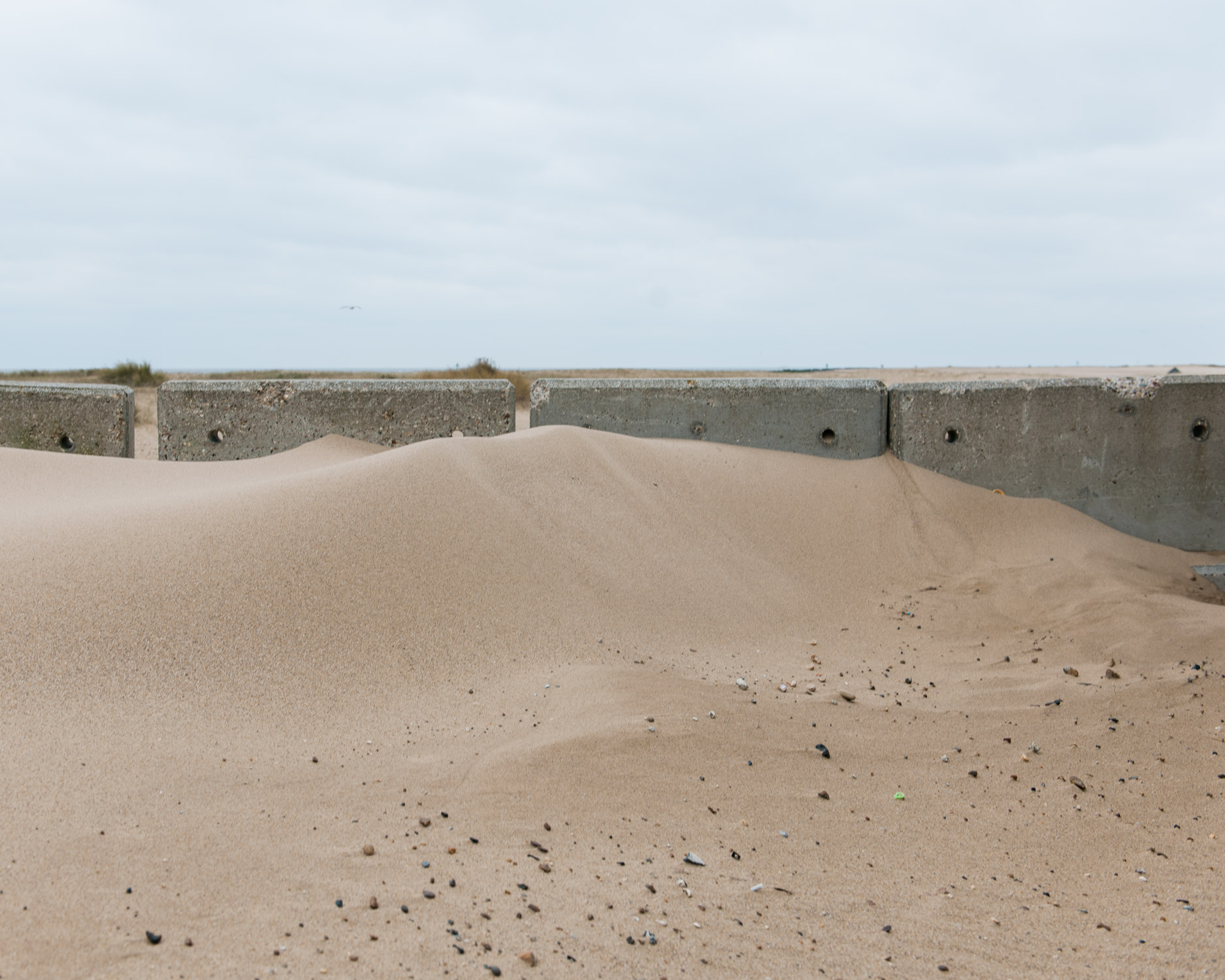 The prevailing wind sweeps the sand North, piling it up on the defences, Jaywick.