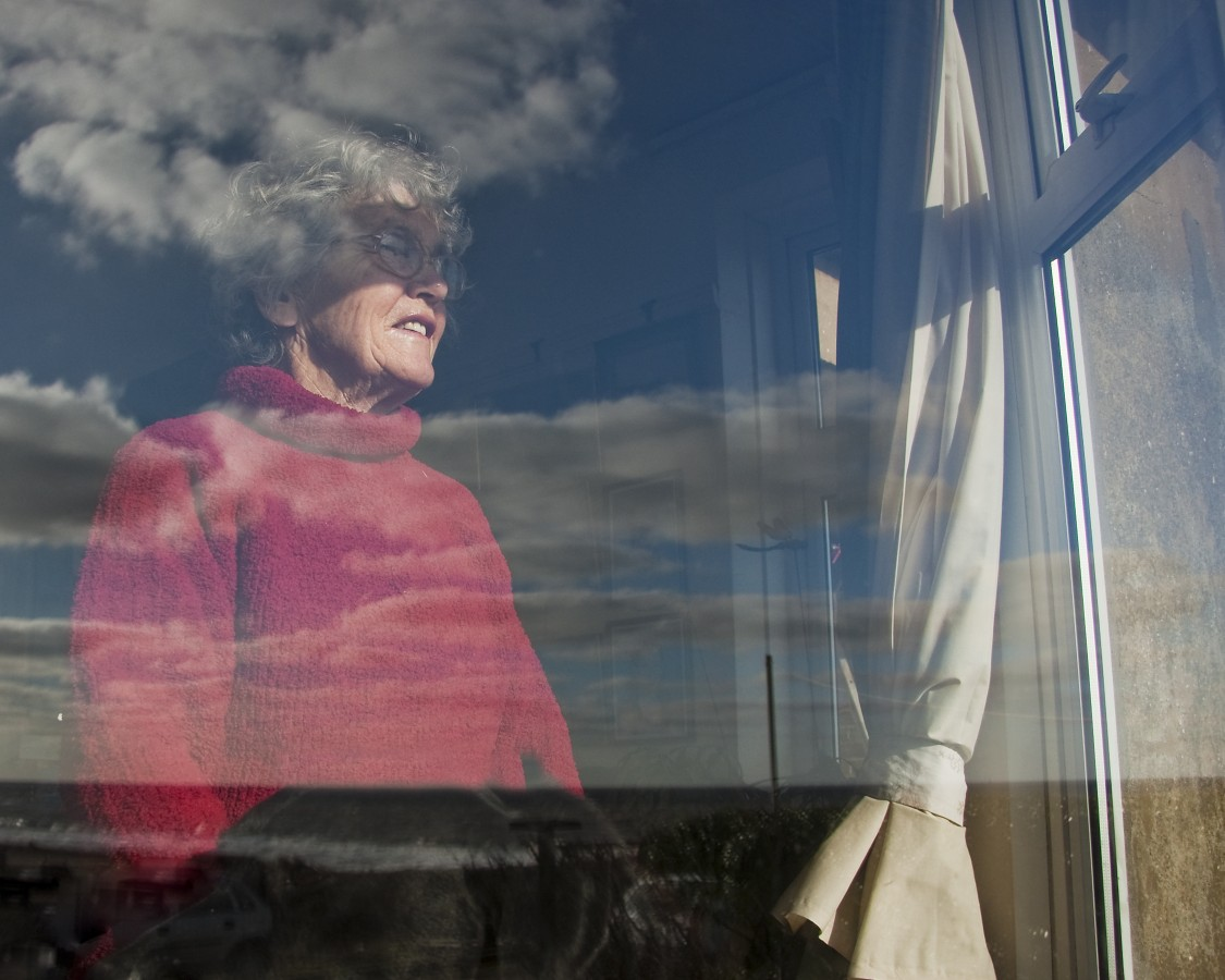 Mrs Boggis gazes out her sea facing window in Easter Bavents, Suffolk. Deprived of fresh supplies of sediment drifting down from the north, the cliffs of Easton Bavents erode fast. At the base, waves launched a devastating offensive, whipped up by the North Sea's notorious winds, while at the top of the cliffs Suffolk's soft, spongey clay proved helpless in the face of percolating rainfall.