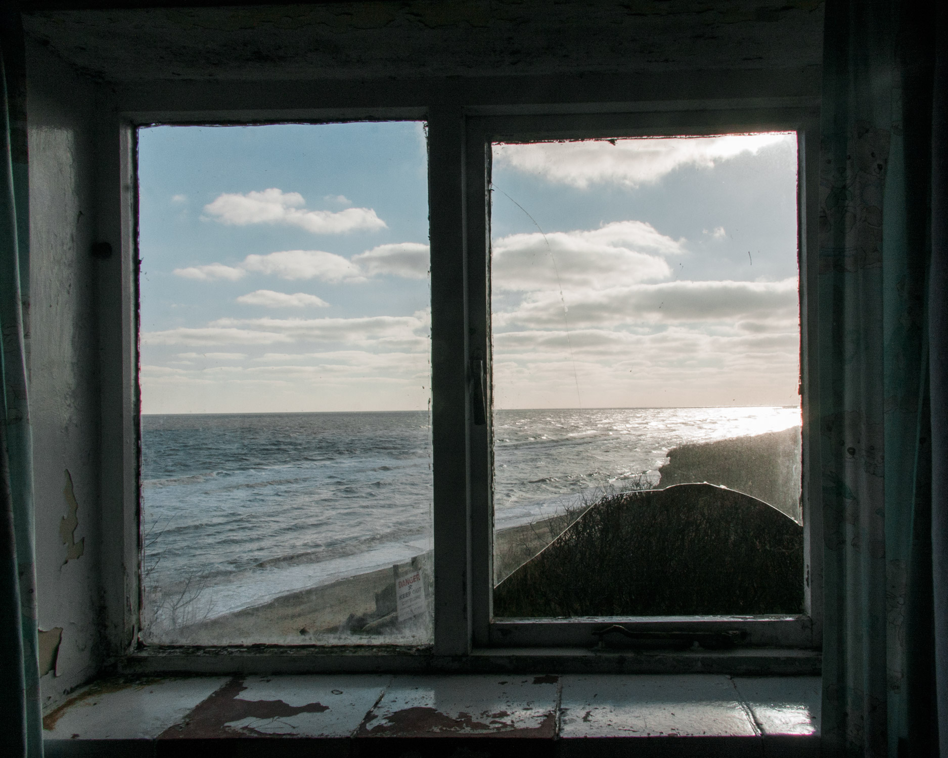 The view from an abandoned house in Eastern Bavents, Suffolk. While defence works at the larger, more popular seaside resorts continues apace, this tiny community's increasingly desperate demands for protection go unheeded by the authorities.