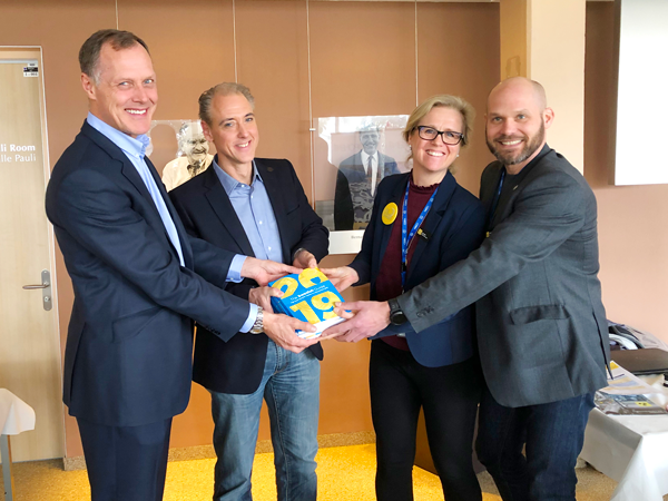 Anders Unnervik, Head of procurements, Richard Jacobsson, Senior physicist CERN, Anna Hall (ILO) och Fredrik Engelmark (ILO) med The Swedish Guide.