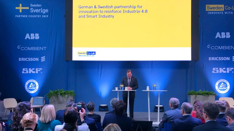 """Från Stefan Löfvéns invigningstal: """"Det är samarbeten som har gjort den svenska industrin så innovativ och dynamisk, det är vi här för att visa dig under de kommande dagarna"""".    Big Science Sweden på Hannover Messe i april 2019"""