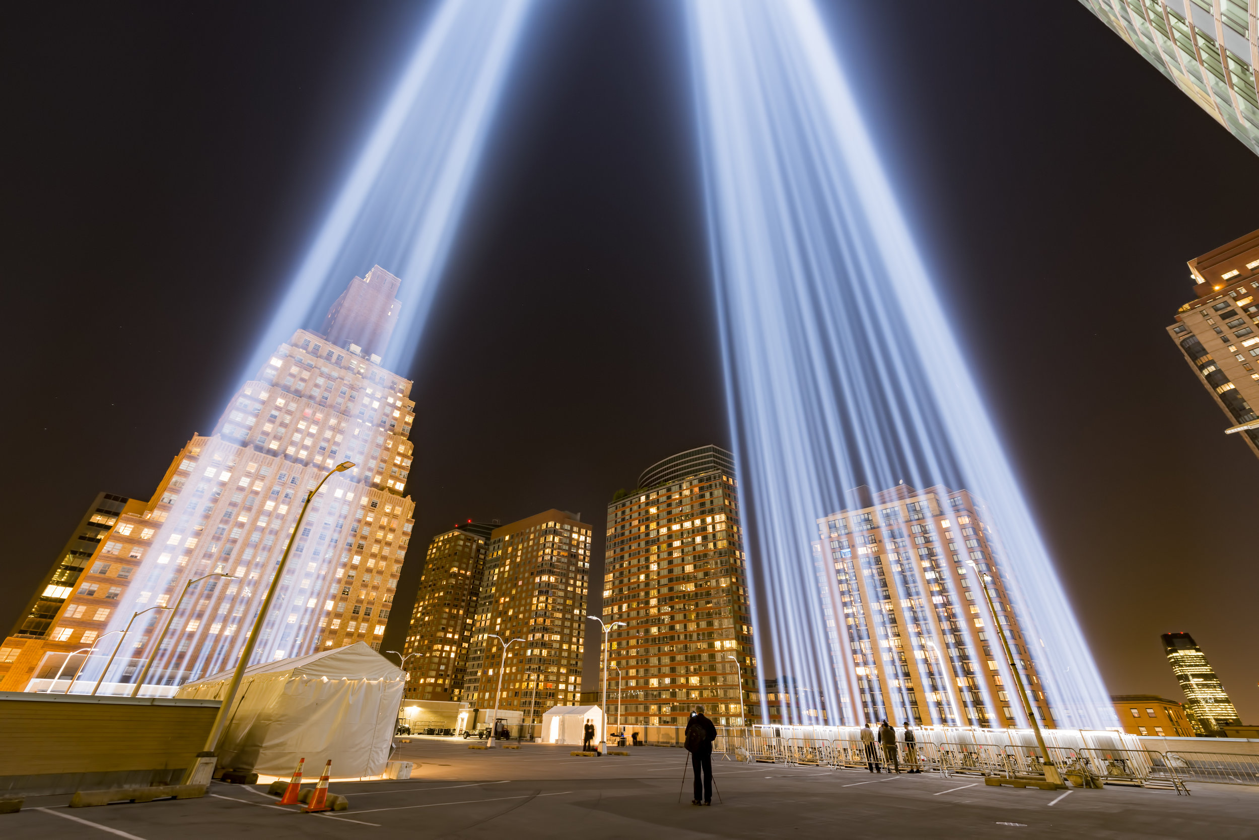 September 2017 I had the amazing opportunity to visit the Tribute of light installation that can be seen across all of New York, It is a memorial to the lives lost in the terrorist attack on the World Trade center. This was taken on the roof of the Battery Parking Garage south of the 9/11 Memorial, the twin beams reach up to four miles into the sky and are comprised of 88 7,000-watt xenon light bulbs positioned into two 48-foot squares, echoing the shape and orientation of the Twin Towers. The shot above is of me lying inside the nearest of the squares of lights shooting up through the centre of the lights to create the image you can see in my landscapes page.