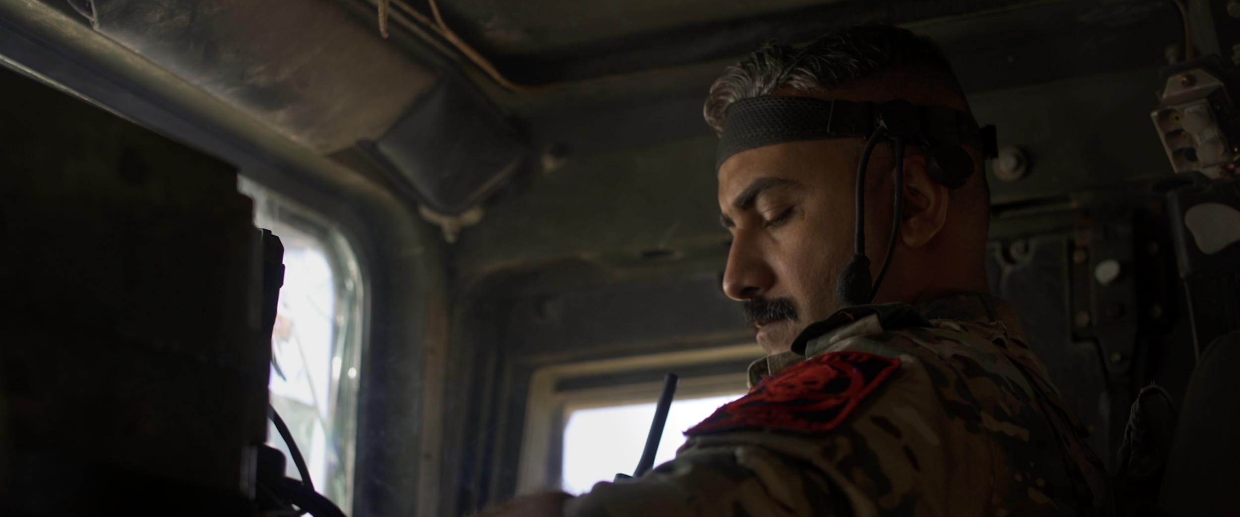 Captain Alaa inside Humvee.png
