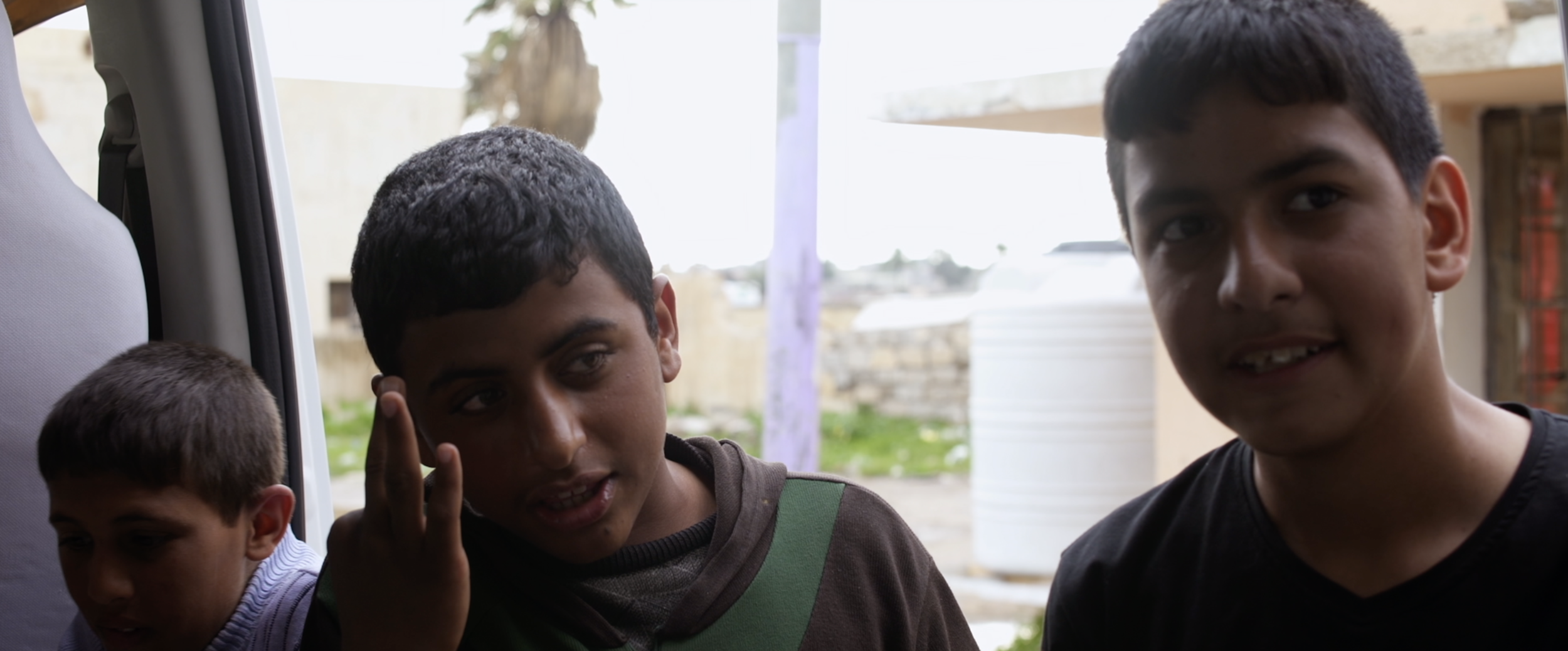 Children from recently liberated towns talk to journalist.png