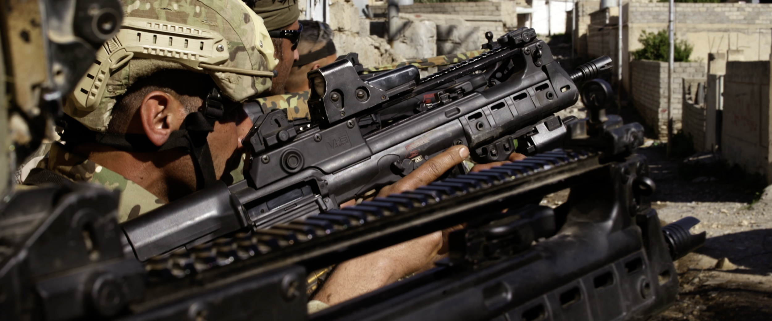 Coalition soldiers pointing rifles.png