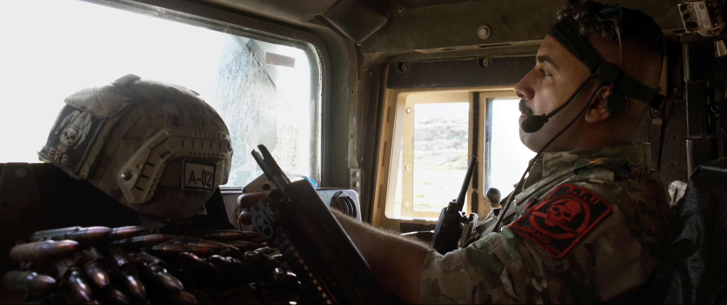 Captain Alaa inside Humvee before battle.png