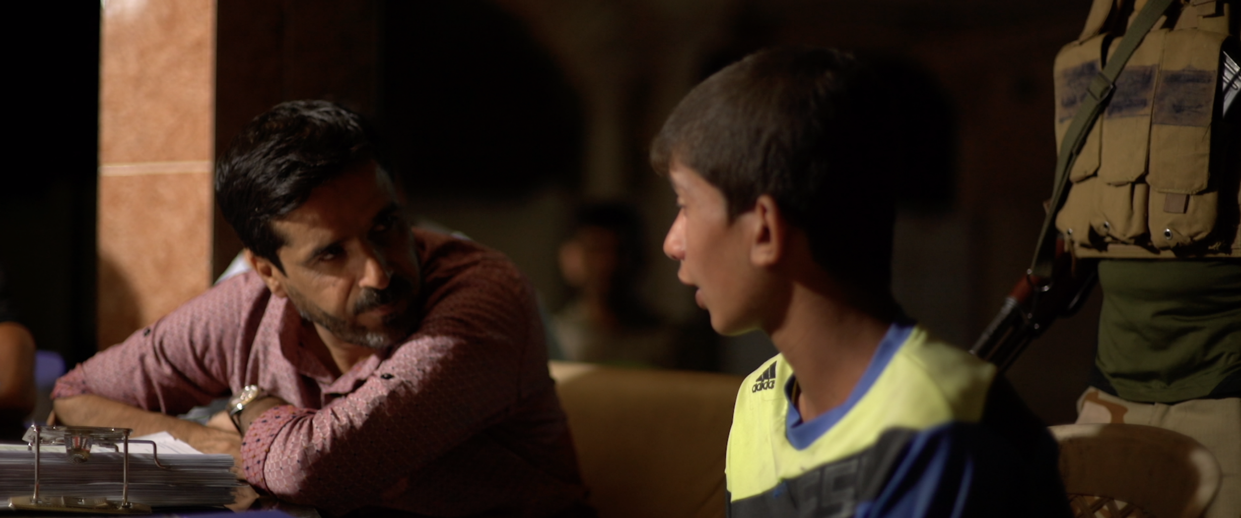 Journalist Ali Maula talks to young Abdullah about life under ISIS.png