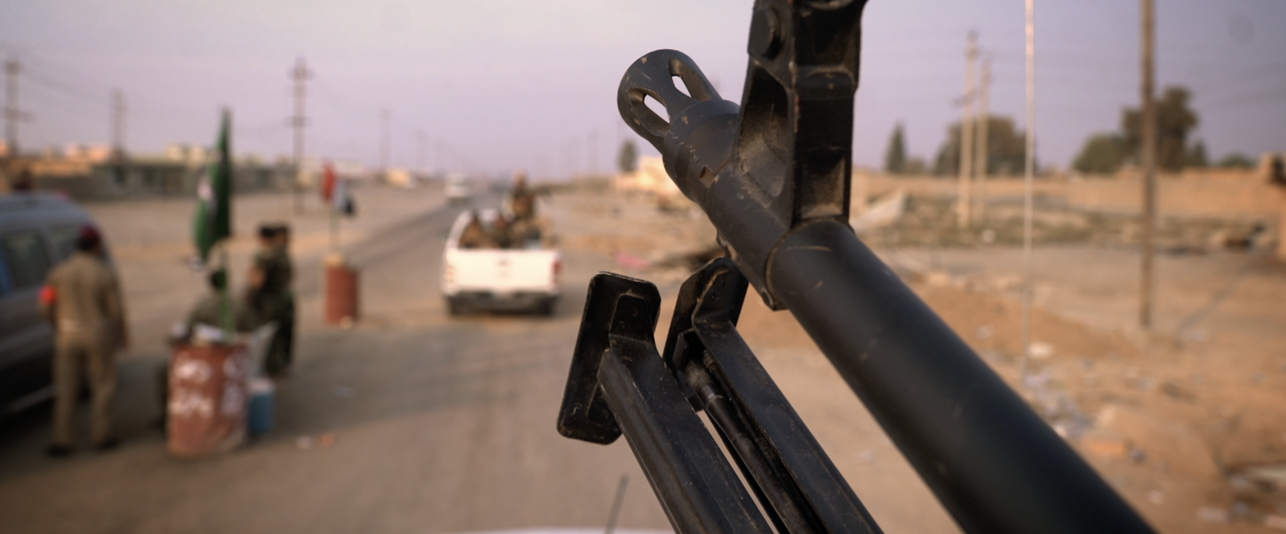 Rifle muzzle overlooking street.png