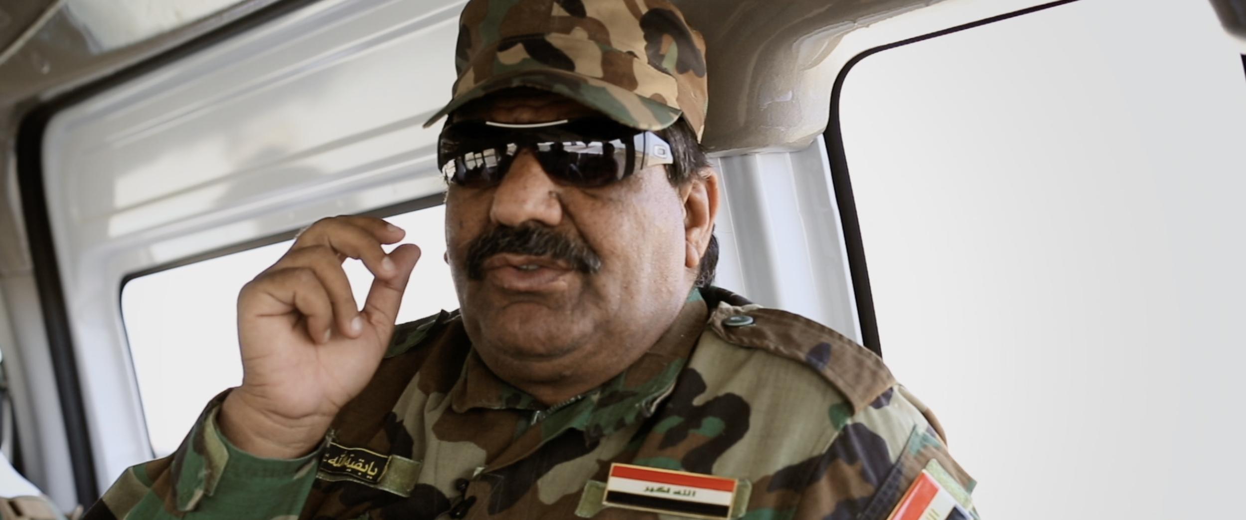 Sheikh Saleh speaking to journalist during ride.png