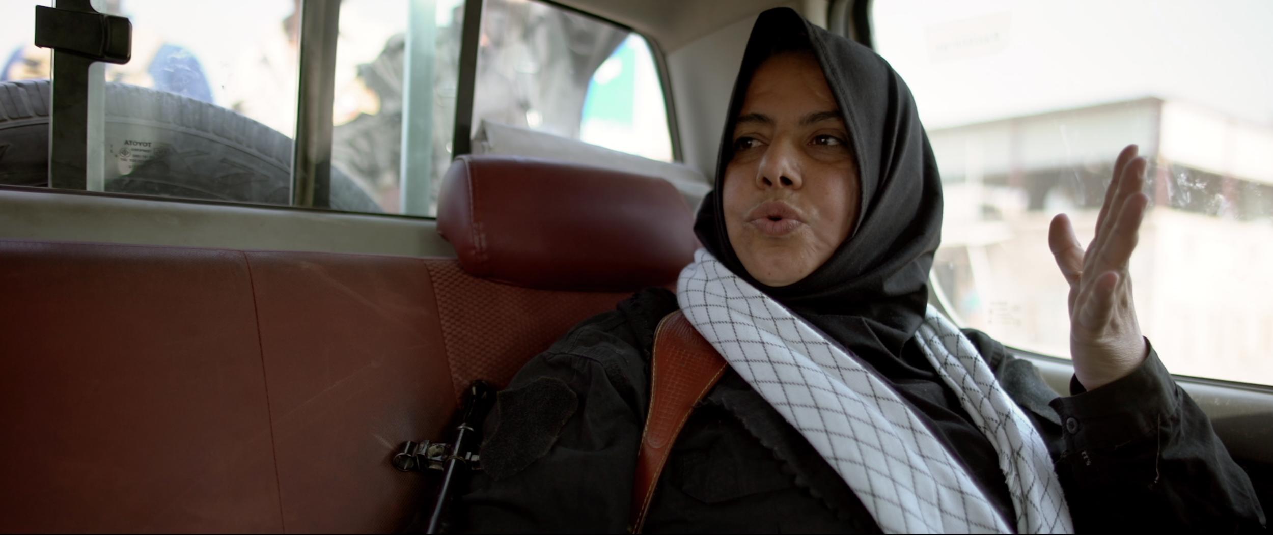Um Hanadi talks to journalist Ali Maula during car ride .png