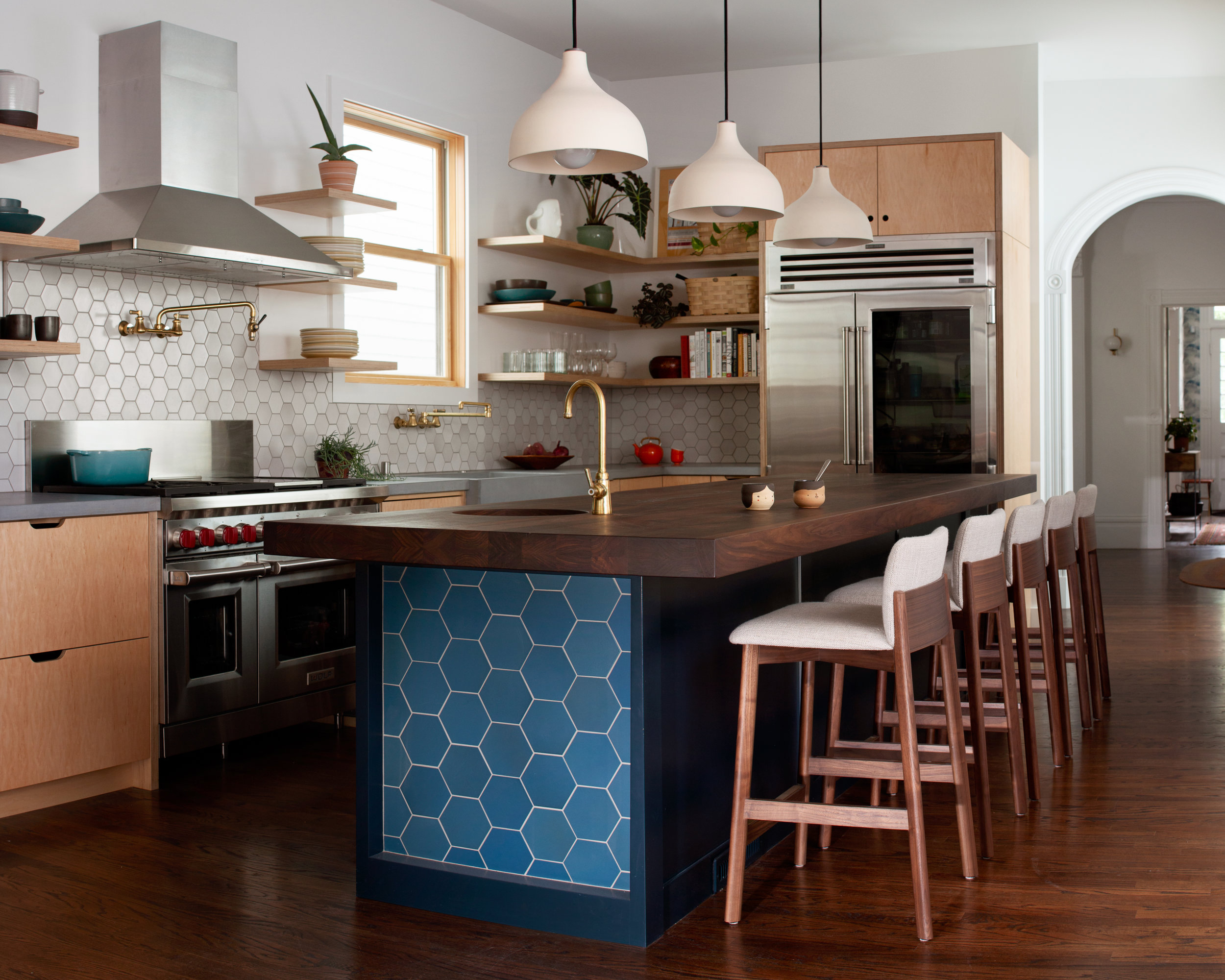 The new kitchen is now the favorite room of the house with more light, functionality and a stylish design. Craig added a beautiful new arch opening into the kitchen.
