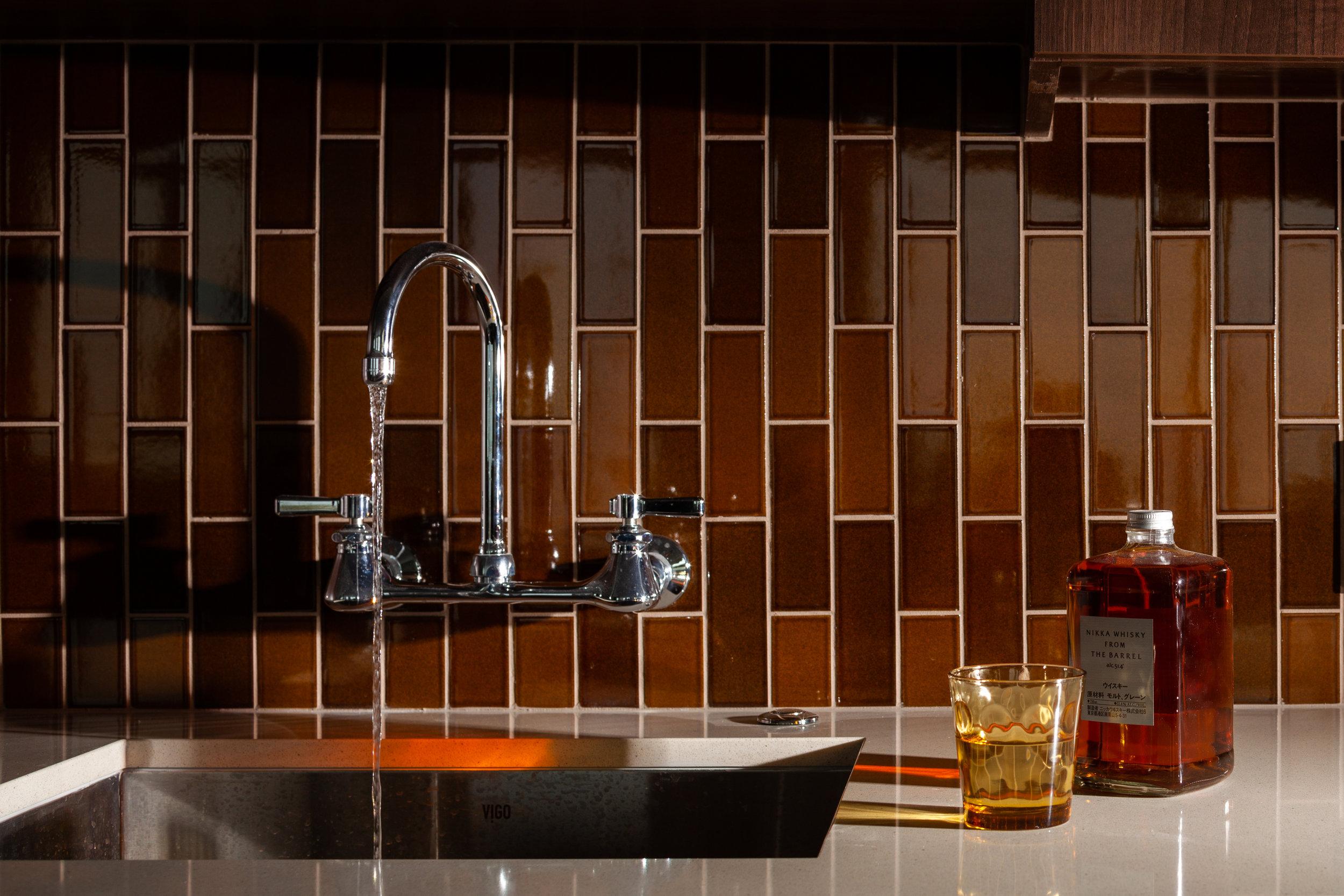 The design details in the kitchen showcase the clients' unique style.