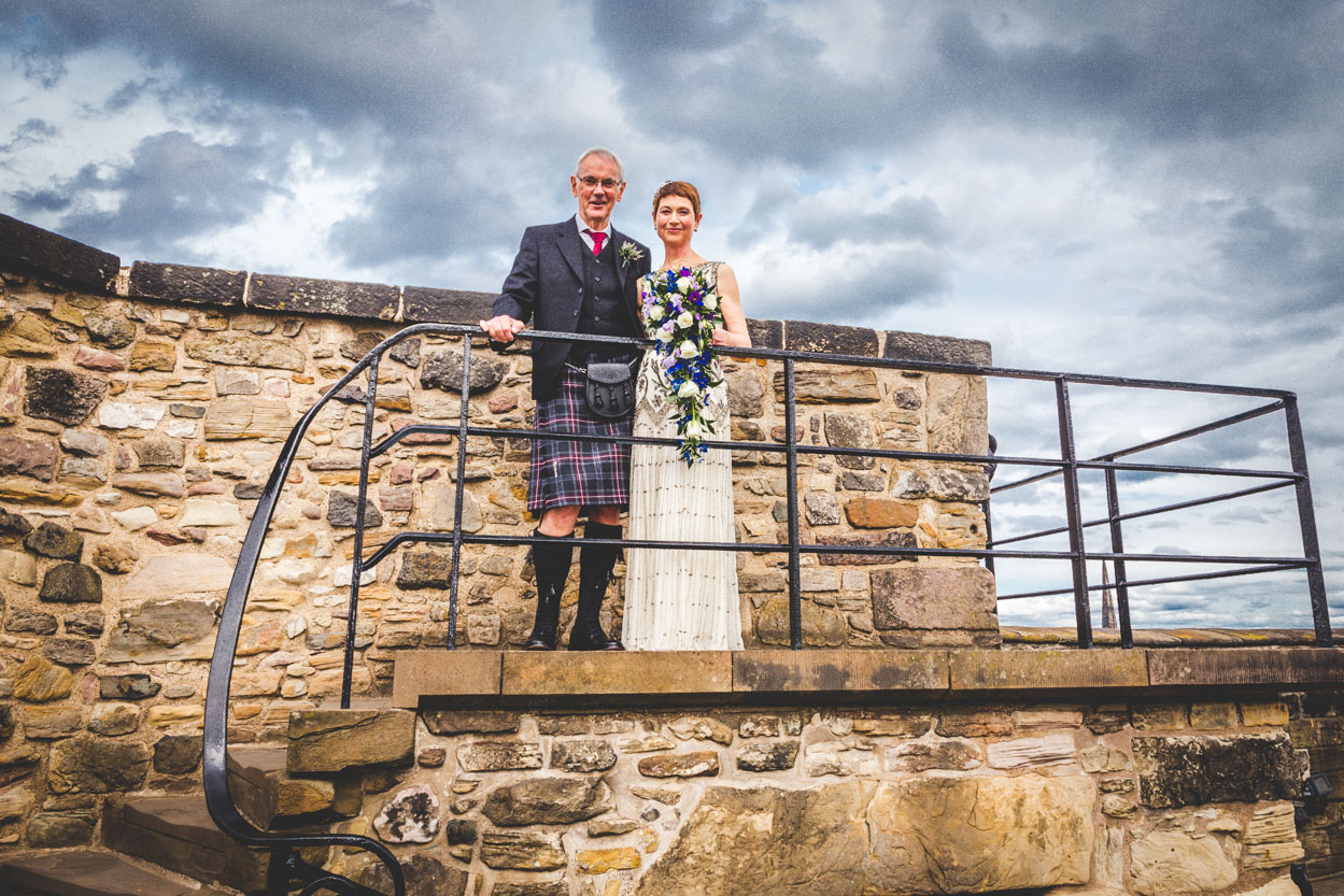 "Ann & George - We met Marcin to talk about our wedding at Edinburgh Castle in August (one of the busiest times at Edinburgh Castle because of the festival) and we were both immediately impressed with his photographs and professionalism. He said he liked to tell a story with his pictures and when we saw our photographs we could see what he meant. One of the many things we like about our photographs is there are the usual posed family groups which we asked him to do but the majority of the photographs taken were of people who were totally unaware they were being taken, especially the children. They are fantastic as they give a real feel of the day which both my new husband and I describe as magical and a very happy and special day. He has caught the atmosphere of St Margaret's Chapel within Edinburgh Castle which is tiny. Marcin makes you feel very relaxed in what can be a stressful time, all be it a wonderful and happy occasion. Marcin also does not do the usual wedding album he presents the photographs in a beautiful wooden box with your names on it. We loved this and when we received it earlier this week it certainly is different and such a lovely way to show family and friends. My ""new husband and I"" would recommend Marcin to do your photographs whatever the occasion and we both can say with complete confidence ""you will not be disappointed"""