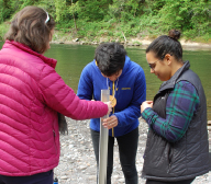 Taylor Smiley Wolfe, Advisor for Rep. Tina Kotek (center) explores water turbidity at Camp Angelos