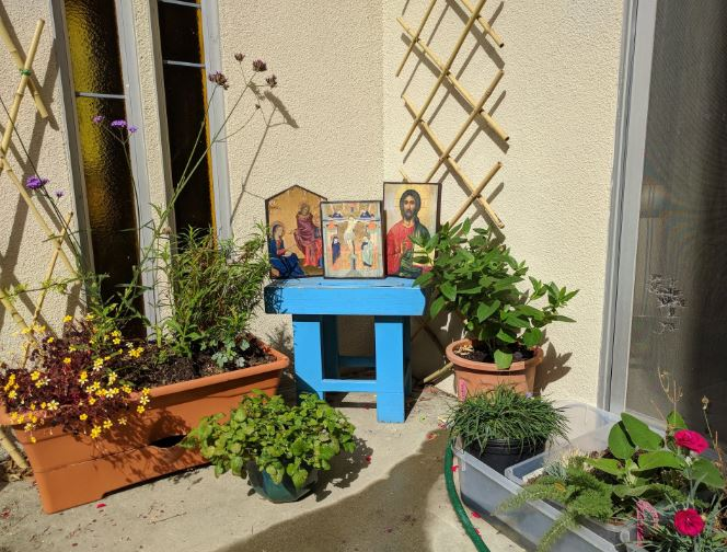 Here's a simple icon corner I created for my courtyard garden where I live. The plants are fairly new so I am waiting for them to mature - and for the vines to climb up the frames - but its getting there.