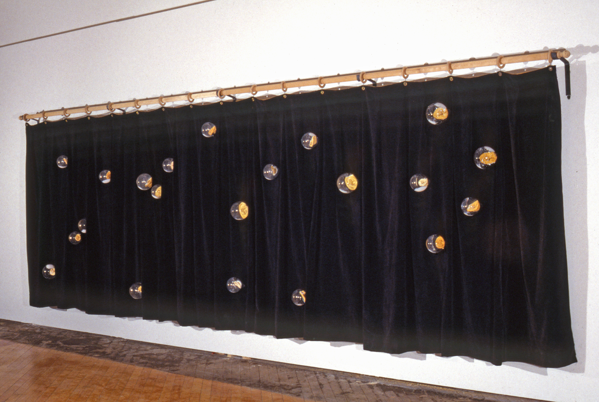 CURTAIN WITH EARS (1994) / Motors, snow globes, cast ears, wood, latex tubing, velvet curtain, 66 x 168 x 11""