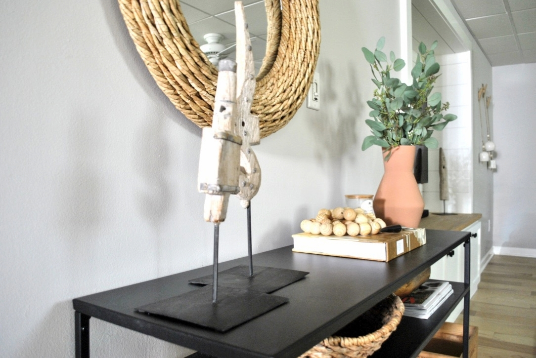 Console table styling with vintage weavers tools and terra cotta vase.
