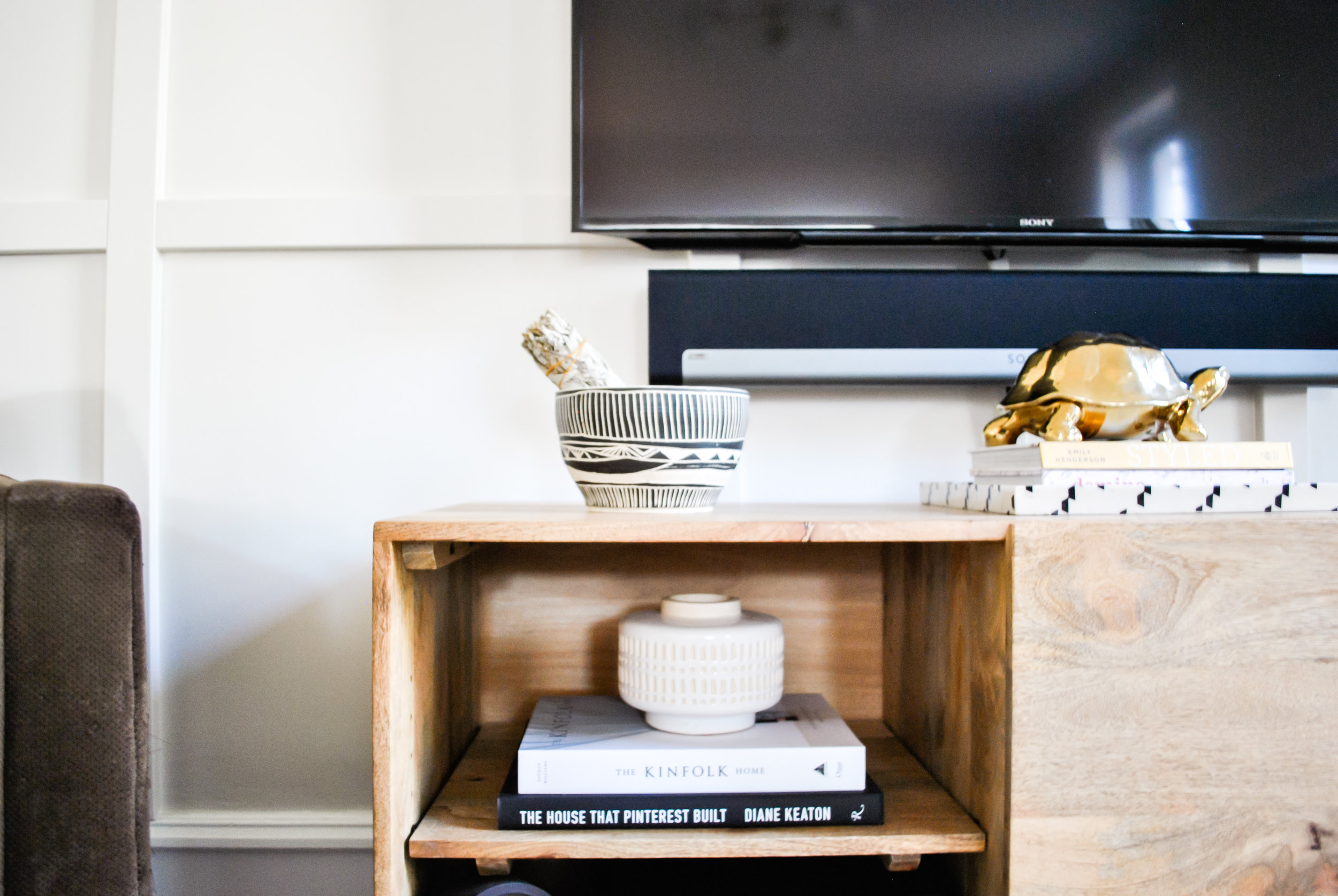 TV console with books in family living room. Designed by Sharp + Grey Interiors Philadelphia