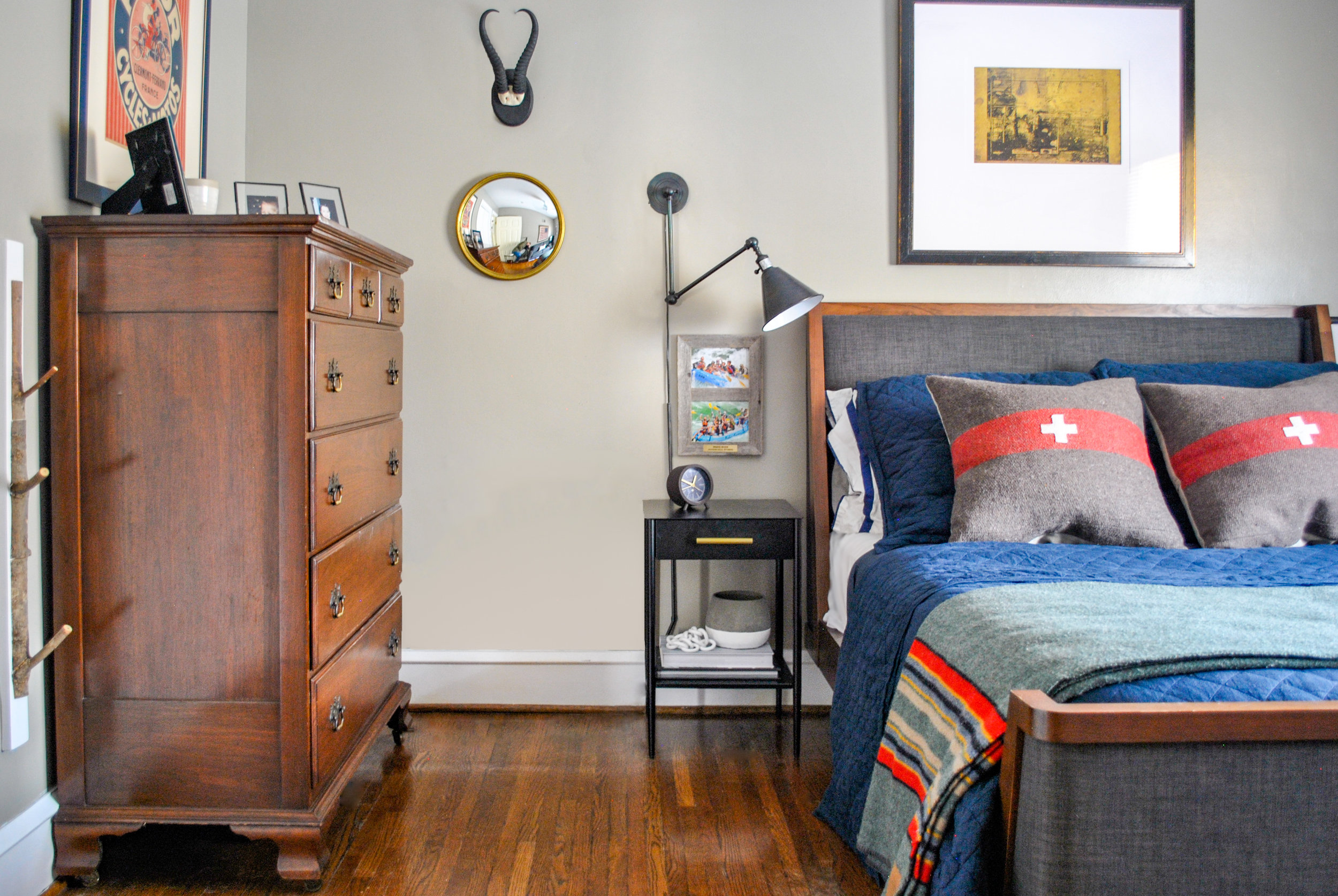 This teen boys bedroom packs a punch in a small space, with vintage army pillows, a camping blanket and unique artwork it has a classic preppy feel, all with a nod to the outdoors. Designed by Sharp + Grey Interiors.