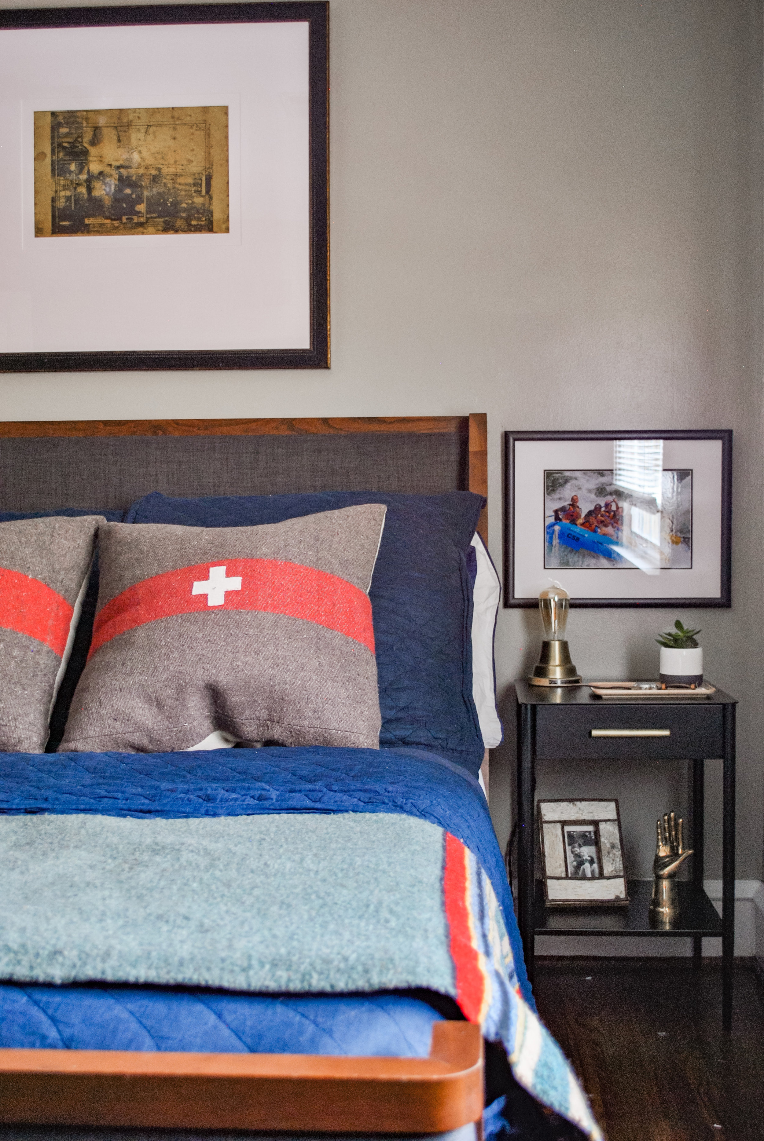 Vintage Swiss Army pillows in this teenage boys bedroom. Designed by Sharp + Grey Interiors.